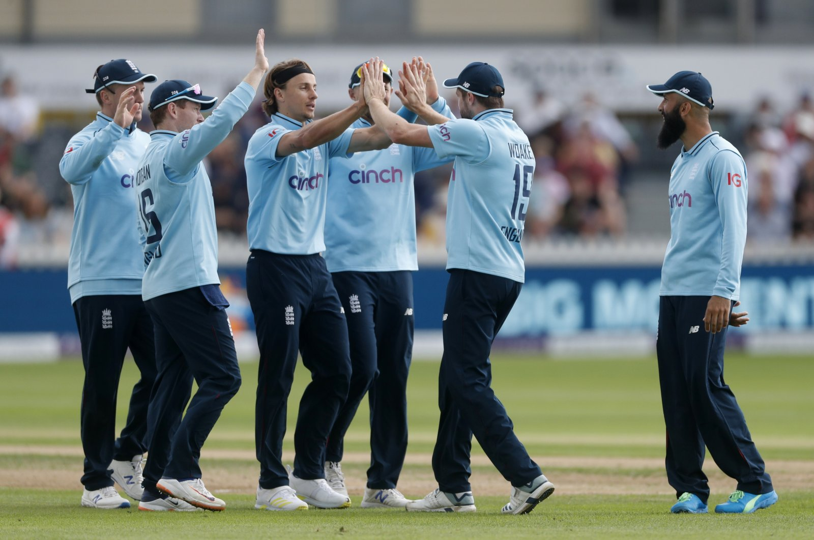England's Chris Woakes (2nd R) celebrates with teammates after taking a catch to dismiss Sri Lanka's Oshada Fernando off the bowling of Tom Curran during an ODI at Bristol County Ground, Bristol, U.K., July 4, 2021. (Reuters Photo)