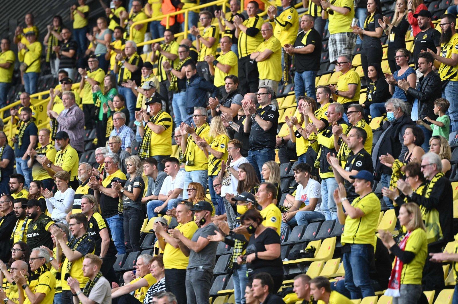 Borussia Dortmund fans applaud during the German Bundesliga football match between Borussia Dortmund and Borussia Monchengladbach in Dortmund, western Germany, Sept. 19, 2020. (AFP Photo)