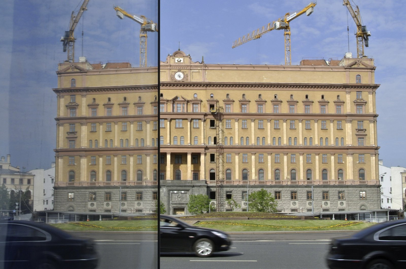 The main building of the Russian Federal Security Services, FSB, reflected in a shop's glass door on Lubyanka Square in Moscow, Russia, May 14, 2013. (AP Photo)