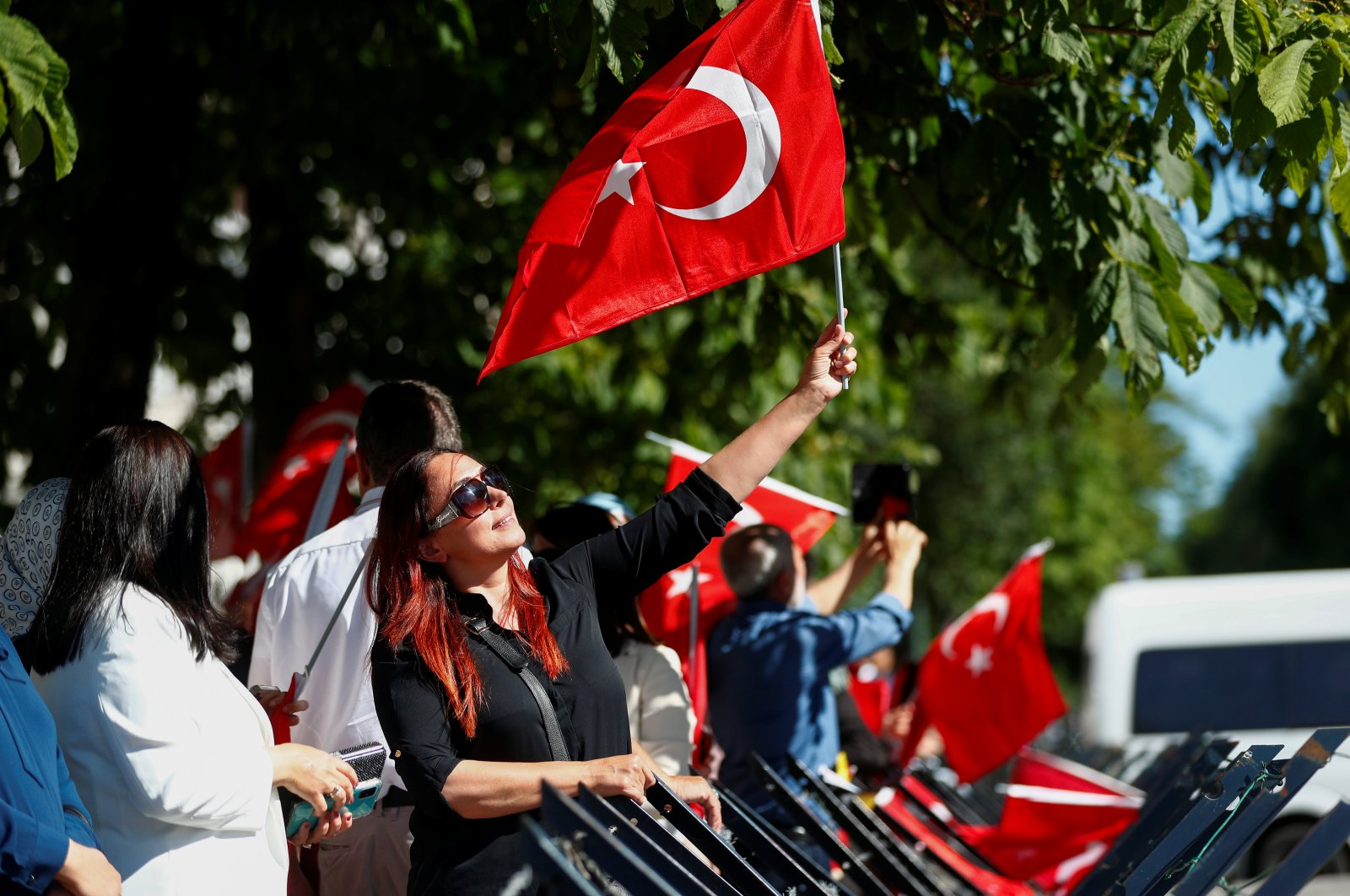 A supporter of President Recep Tayyip Erdoğan holds a flag while waiting in front of his hotel in Brussels, Belgium, June 13, 2021. (Reuters File Photo)