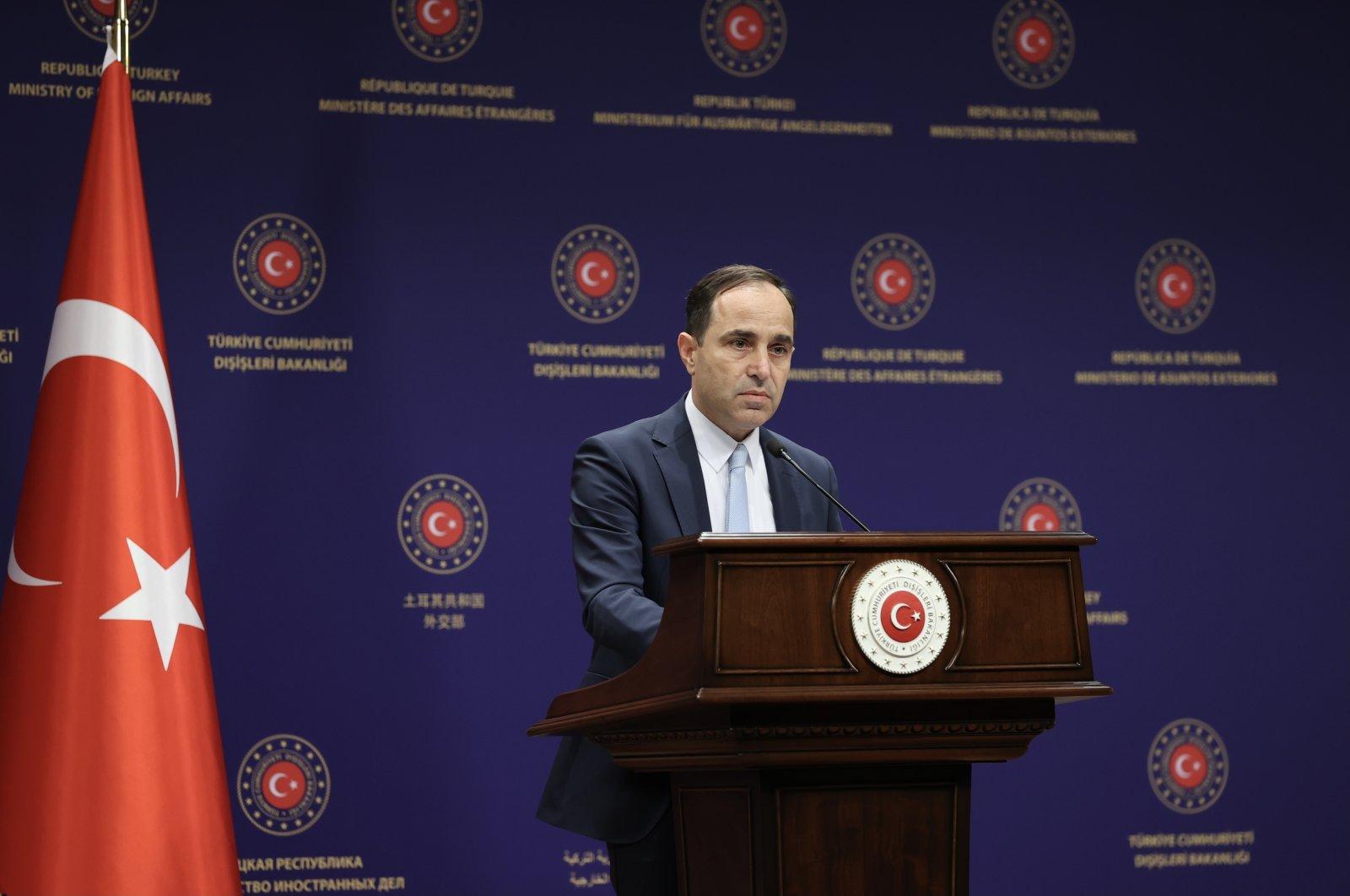 Foreign Ministry spokesperson Tanju Bilgiç listens during a press conference in Ankara, Turkey, June 25, 2021. (AA File Photo)
