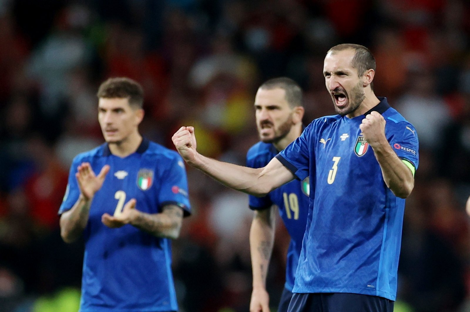 Italy's Leonardo Bonucci and Giorgio Chiellini react during the penalty shootout in the semifinal match between Italy and Spain at the Wembley Stadium, London, U.K., on July 6, 2021. (Reuters Photo)