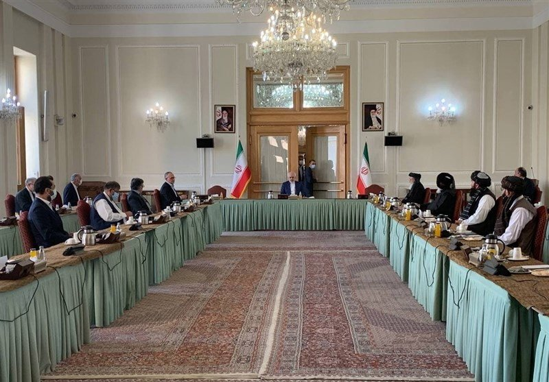 Iranian Foreign Minister Mohammad Javad Zarif (C) talks to delegations of the Afghanistan government (L) and the Taliban (R) at the Iranian Foreign Ministry office in Tehran, Iran, July 7, 2021. (EPA Photo)