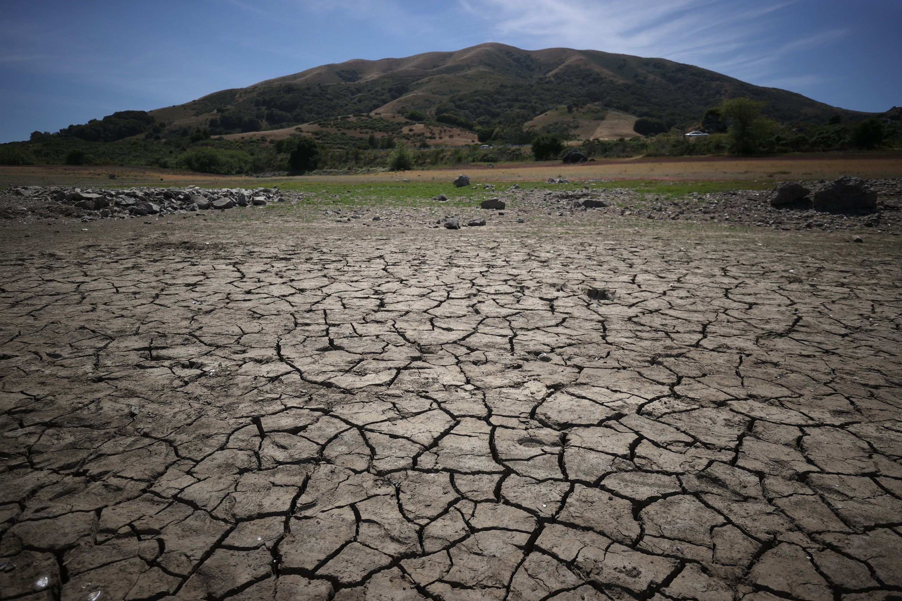 Dry cracked earth as a result of drought at Nicasio Reservoir in Nicasio, California, U.S., on May 28, 2021. (Getty Images)