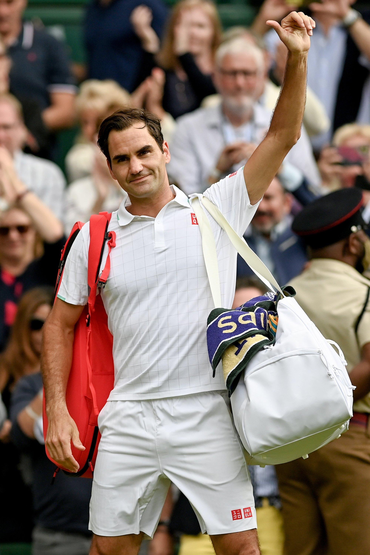 Switzerland's Roger Federer reacts as he leaves the court after the Wimbledon men's quarterfinal match against Poland's Hubert Hurkacz, in Wimbledon, Britain, July 7, 2021. (EPA Photo)