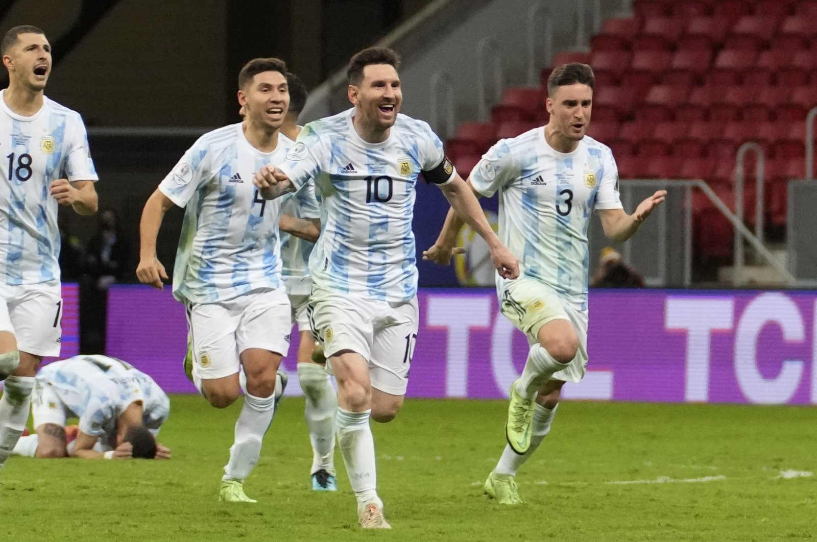 Argentina's Lionel Messi (10) and teammates celebrate defeating Colombia in a penalty shootout during a Copa America semifinal football match at the National stadium in Brasilia, Brazil, July 7, 2021. (AP Photo)