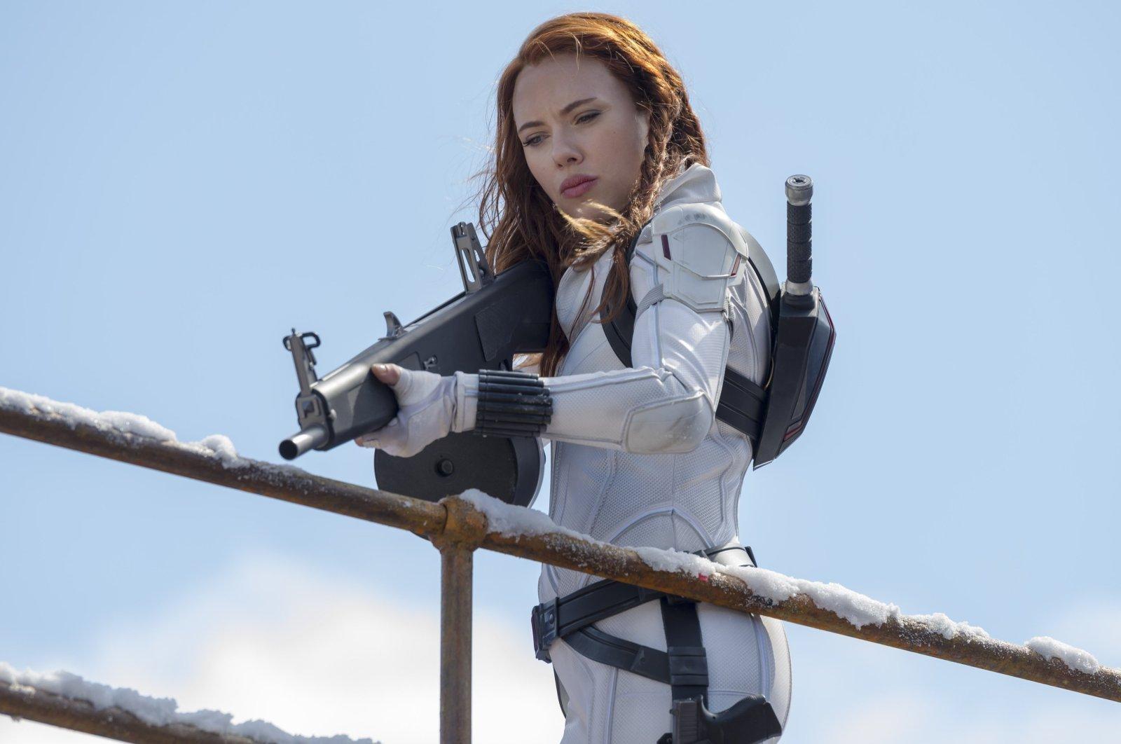 Scarlett Johansson wields a weapon in a scene from Marvel superhero film 'Black Widow.' (Disney via AP)
