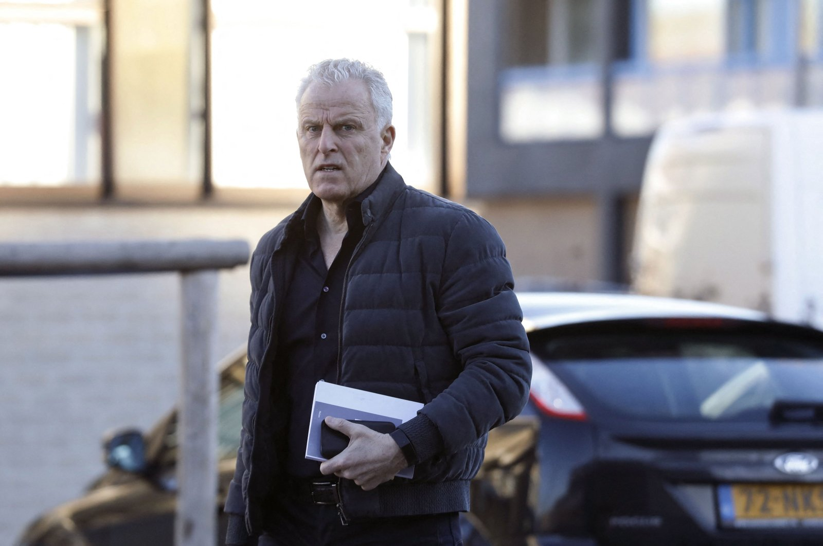 Dutch crime reporter Peter R. de Vries arrives at the heavily secured courtroom in Amsterdam, the Netherlands, Feb. 15, 2019. (AFP Photo)