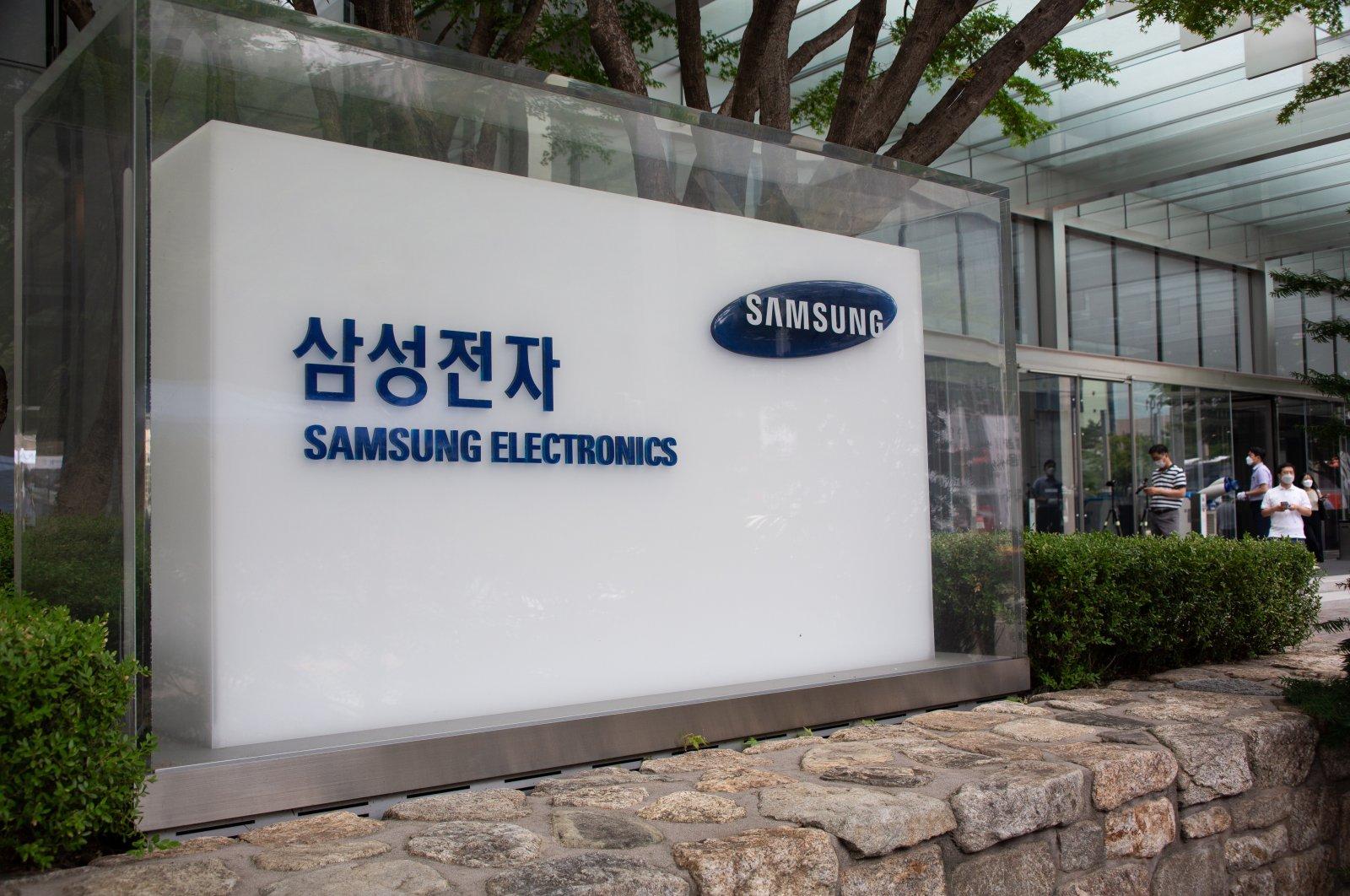 People walk outside the Samsung Electronics headquarters in Seoul, South Korea, July 7, 2021. (EPA Photo)
