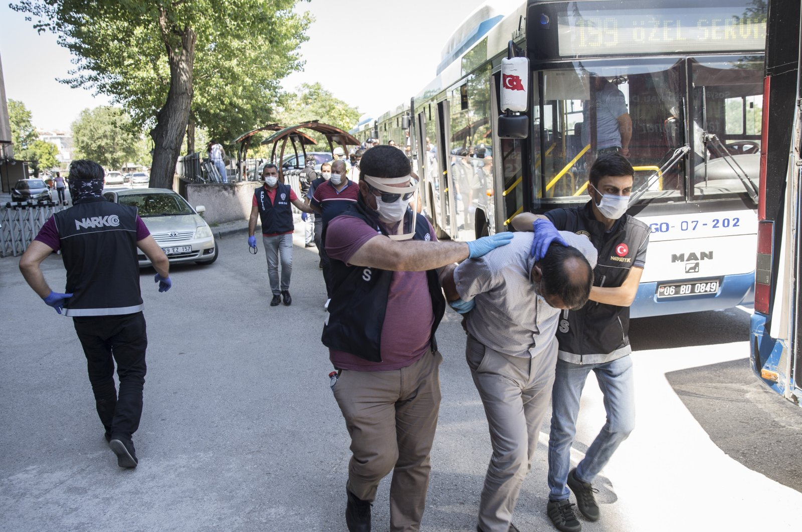 Police escort suspects captured in Operation Swamp to the courthouse in the capital, Ankara, Turkey, July 5, 2020. (AA PHOTO)