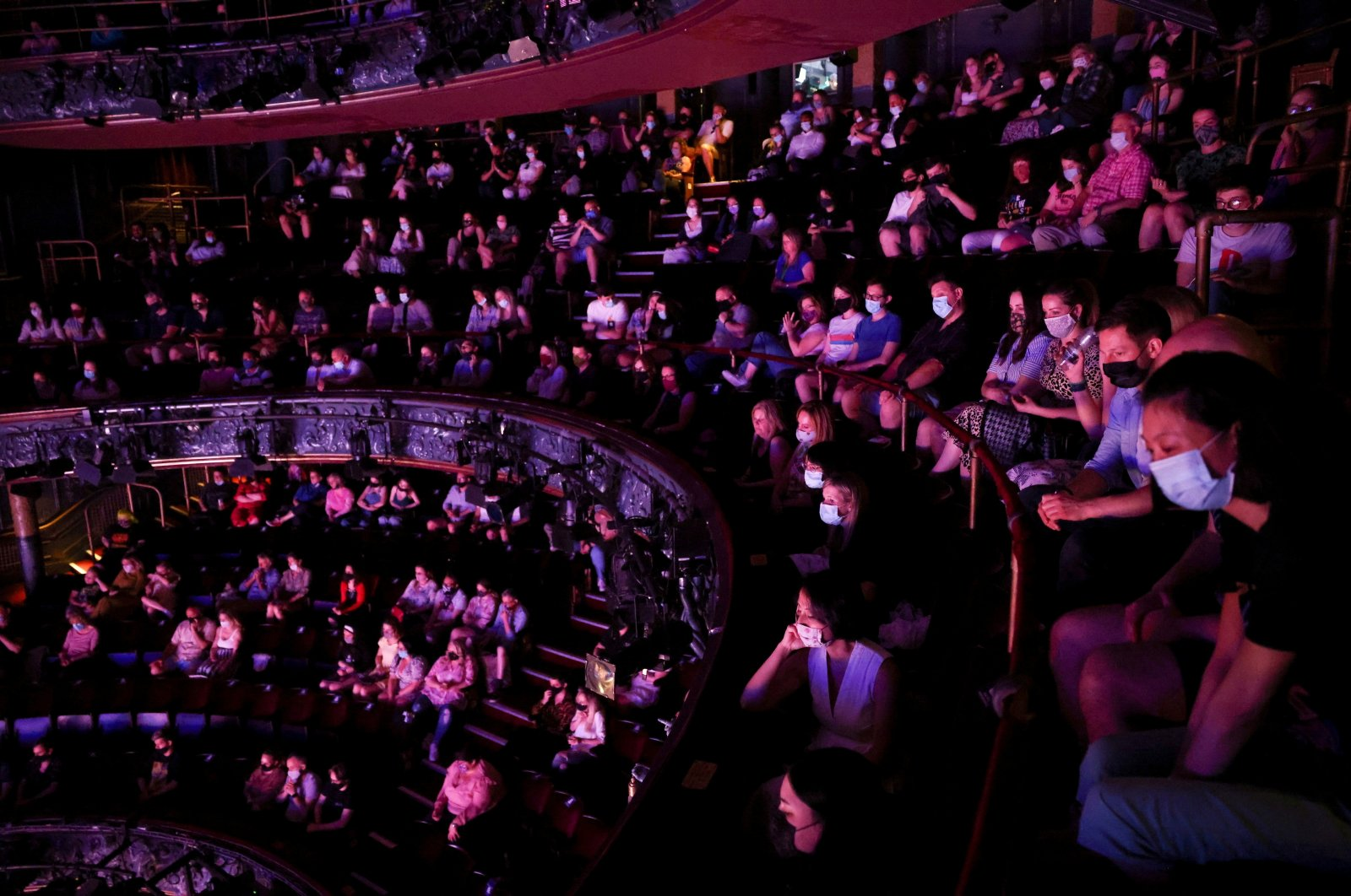 """Guests watch a performance of the West End show """"The Show Must Go On"""" at the Palace Theater, amid the spread of COVID-19 in London, U.K., June 2, 2021. (Reuters Photo)"""