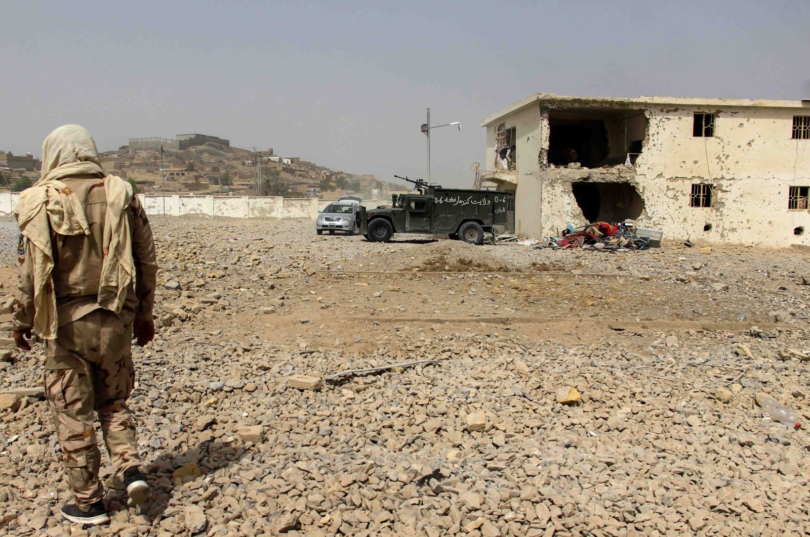 Afghan security officials inspect the scene of a bomb blast in Kandahar, Afghanistan, July 6, 2021. (EPA Photo)