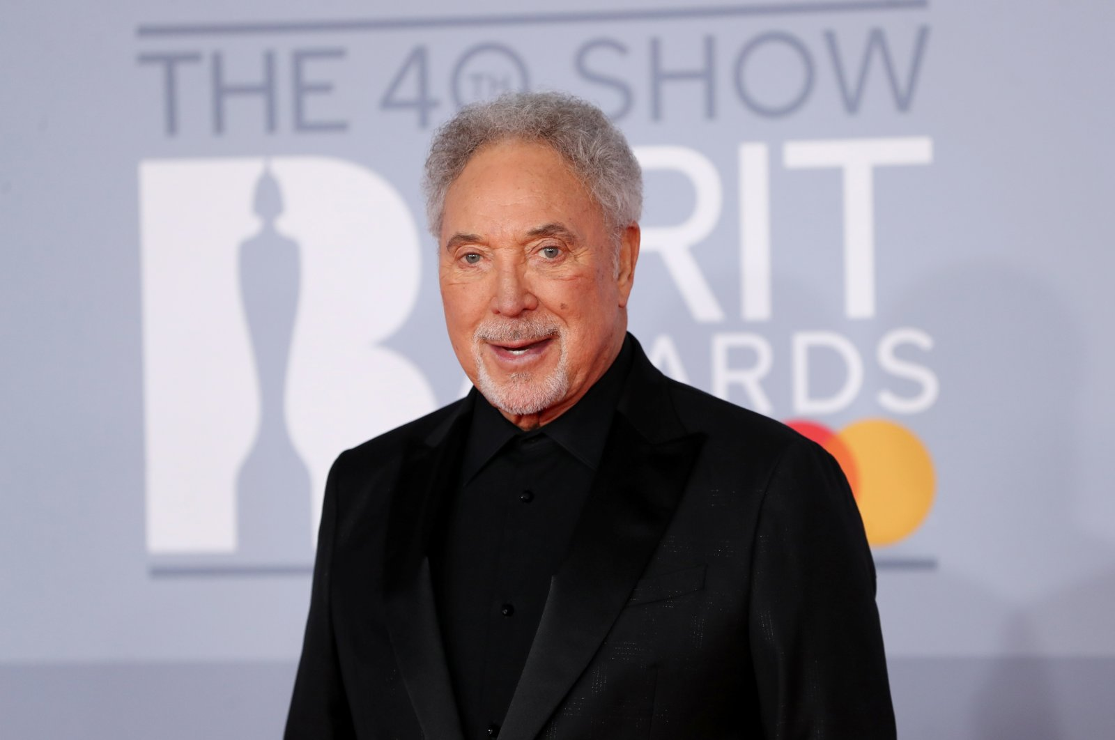 Tom Jones poses as he arrives for the Brit Awards at the O2 Arena in London, U.K., Feb. 18, 2020. (Reuters Photo)