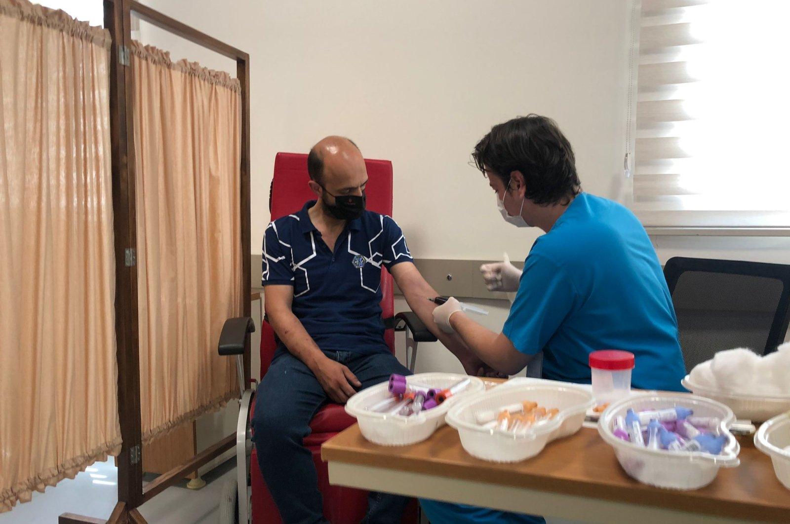 A volunteer is injected with a VLP-based vaccine, in Istanbul, Turkey, July 5, 2021. (DHA PHOTO)