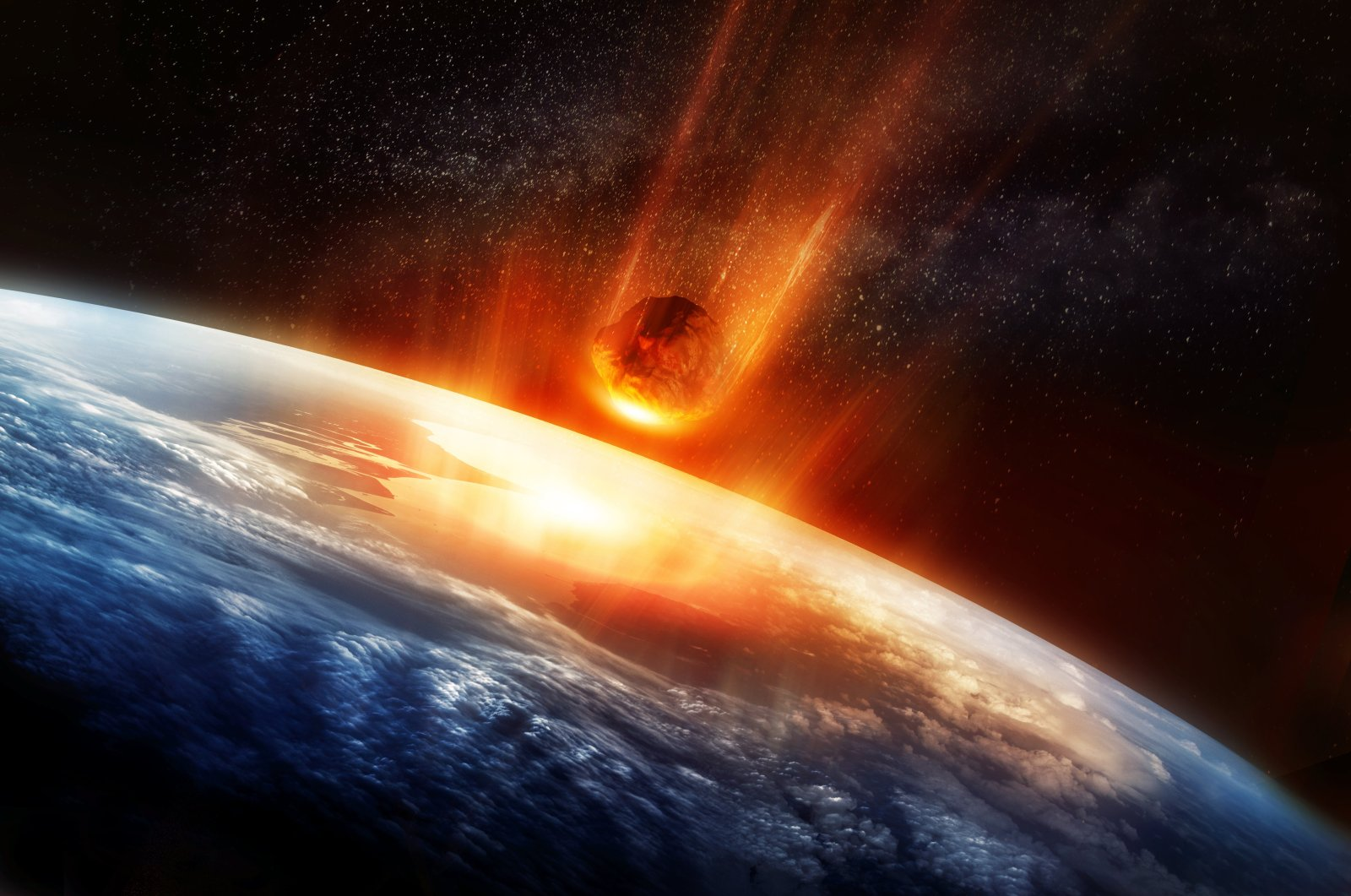 This 3D illustration shows a large meteor burning up as it hits Earth's atmosphere. (Getty Images)