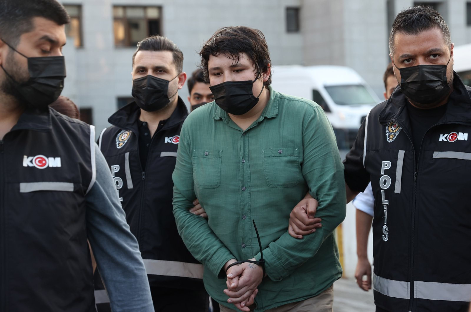 Mehmet Aydın (C) is escorted by Turkish police to the court after a check-up at the Bayrampaşa State Hospital, Istanbul, Turkey, July 7, 2021. (AA Photo)