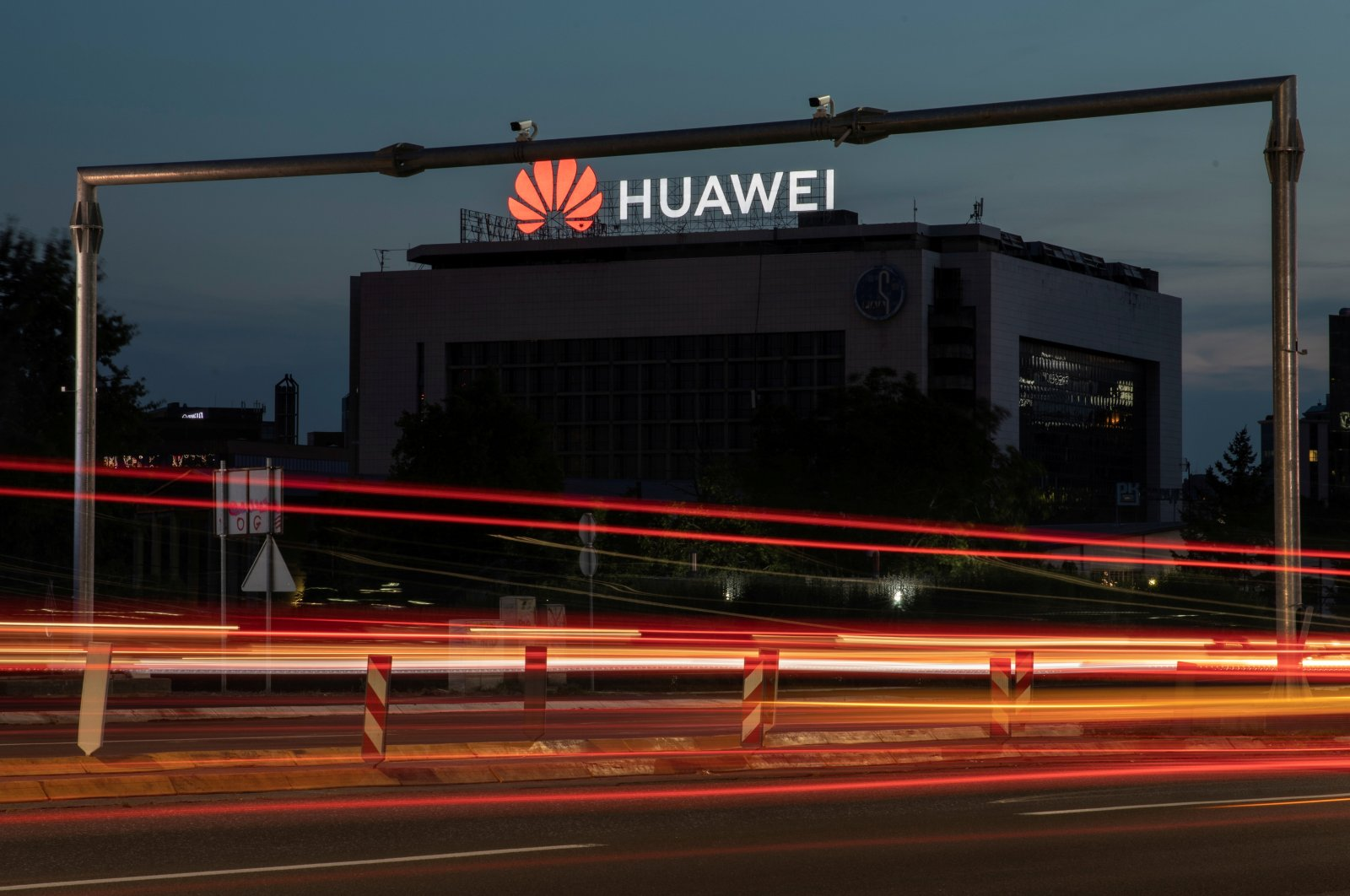 Surveillance cameras are seen in front of a Huawei logo in Belgrade, Serbia, Aug.11, 2020. (Reuters Photo)