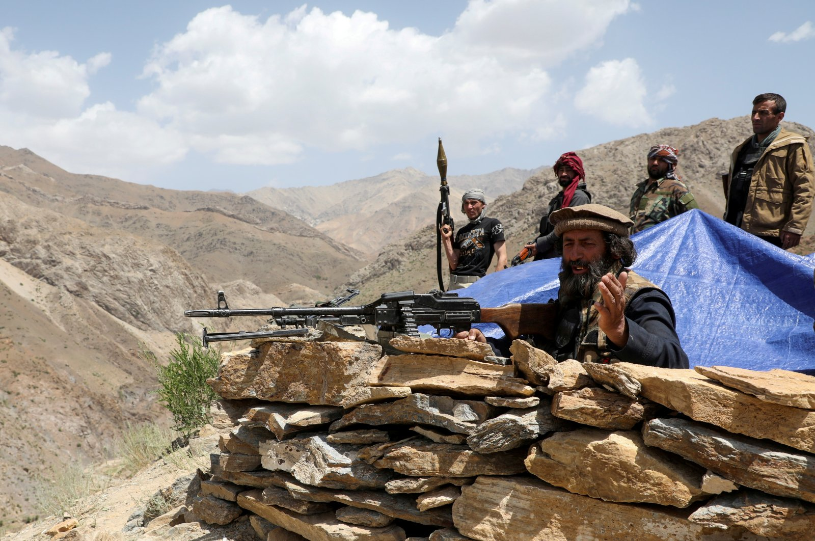 Armed men who are against the Taliban uprising stand at their check post, at the Ghorband District, Parwan Province, Afghanistan, June 29, 2021. (Reuters Photo)