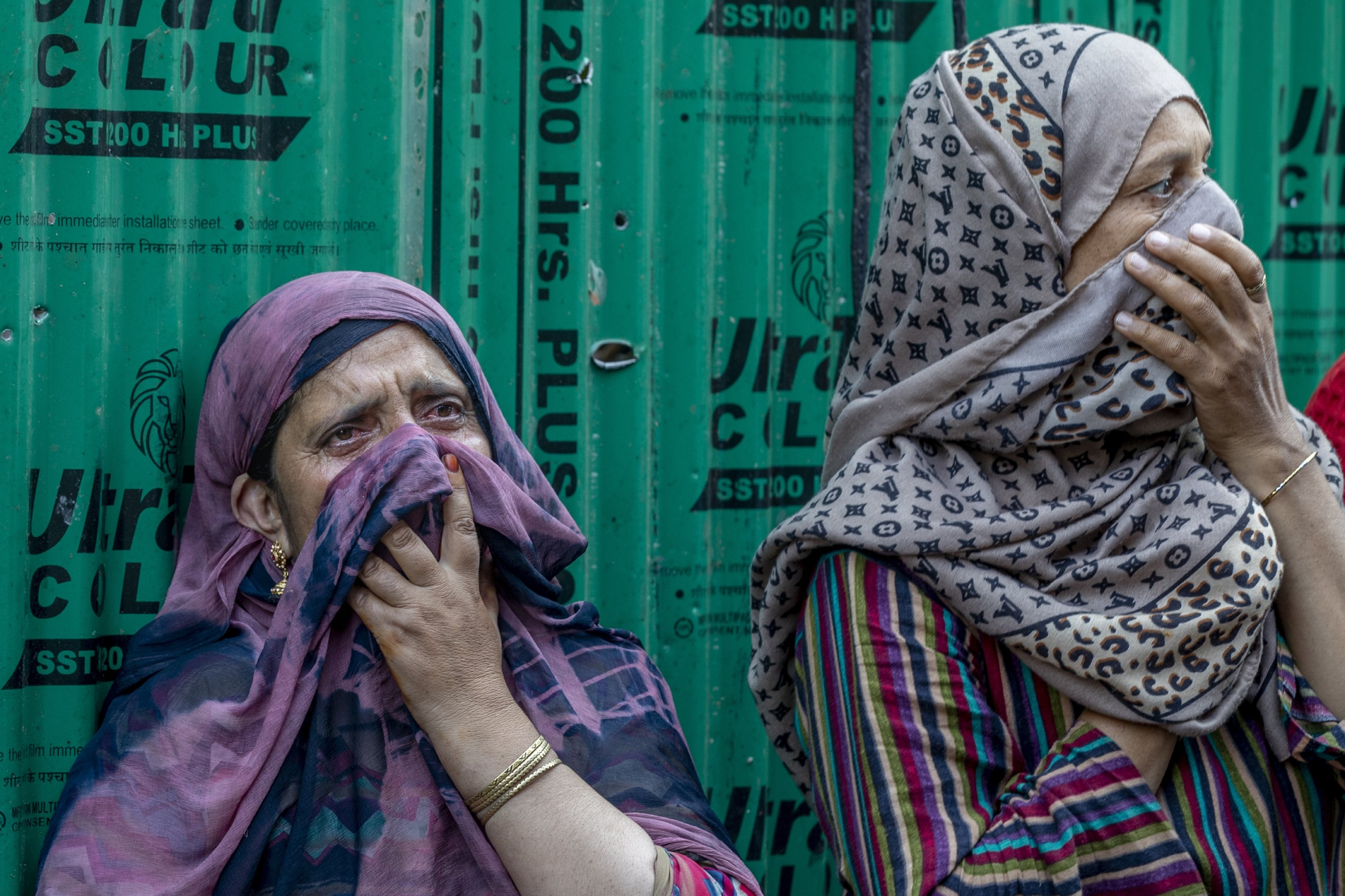 Kashmiri villagers inspect a damaged residential house where suspected rebels were taking refuge, after a gunfight in Pulwama, south of Srinagar, Indian-controlled Kashmir, July 2, 2021. (AP Photo)