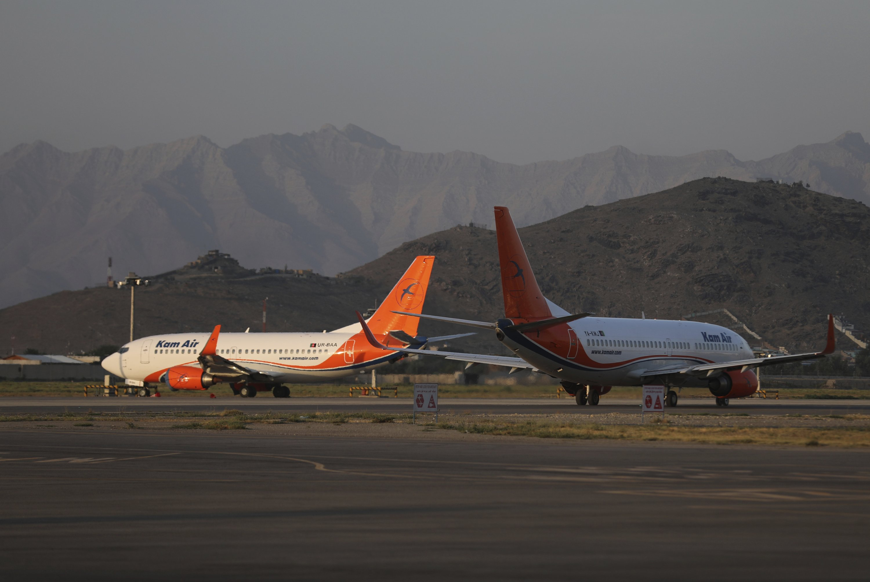 Kam Air planes are parked at Hamid Karzai International Airport in Kabul, Afghanistan, July 4, 2021. (AP Photo)
