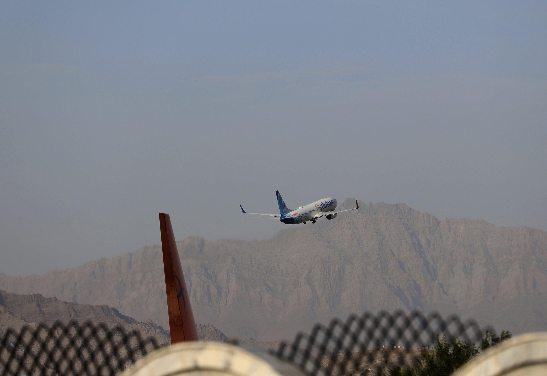 A plane departs Hamid Karzai International Airport in Kabul, Afghanistan, Sunday, July 4, 2021. (AP Photo/Rahmat Gul)