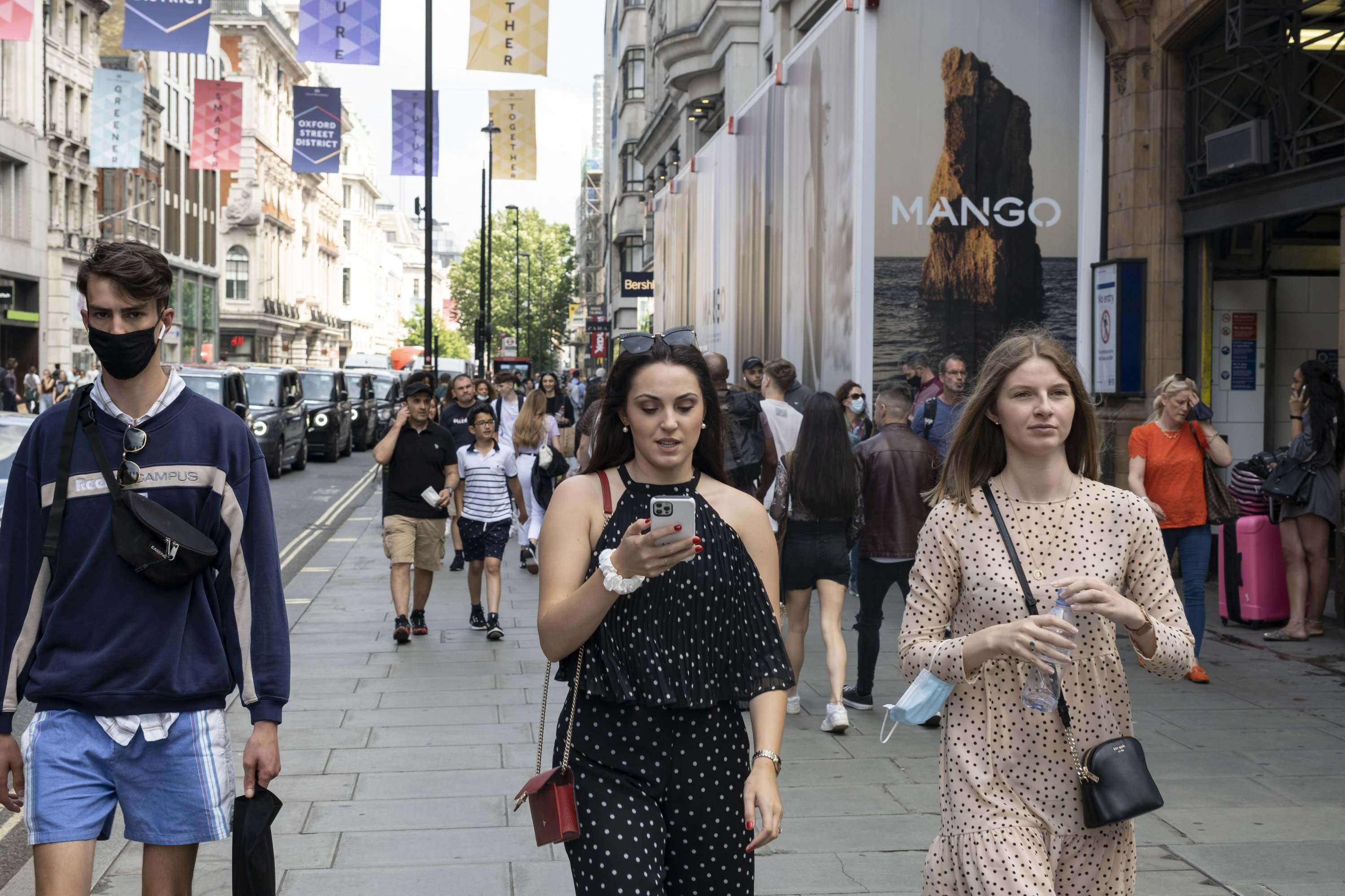 As the national coronavirus lockdown three eases towards the planned 'Freedom Day' in just over two weeks, people, many of whom are still wearing face masks while out on the street, come to Oxford Street shopping district in London, U.K., on July 22, 2021. (Getty Images)