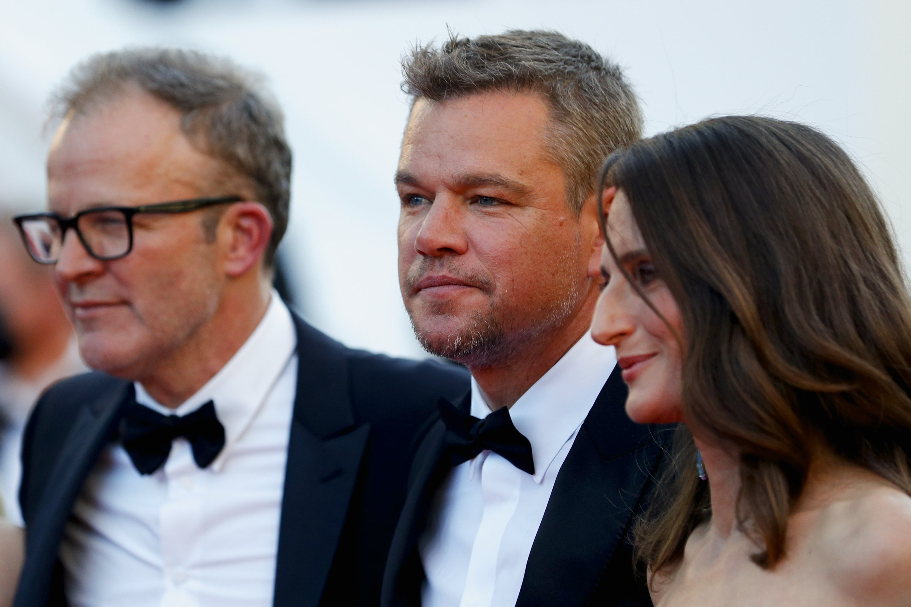 Director Tom McCarthy (L) and cast members Matt Damon (C) and Camille Cottin pose for a photo on the red carpet at the 74th Cannes Film Festival, Cannes, France, July 8, 2021. (Reuters Photo)