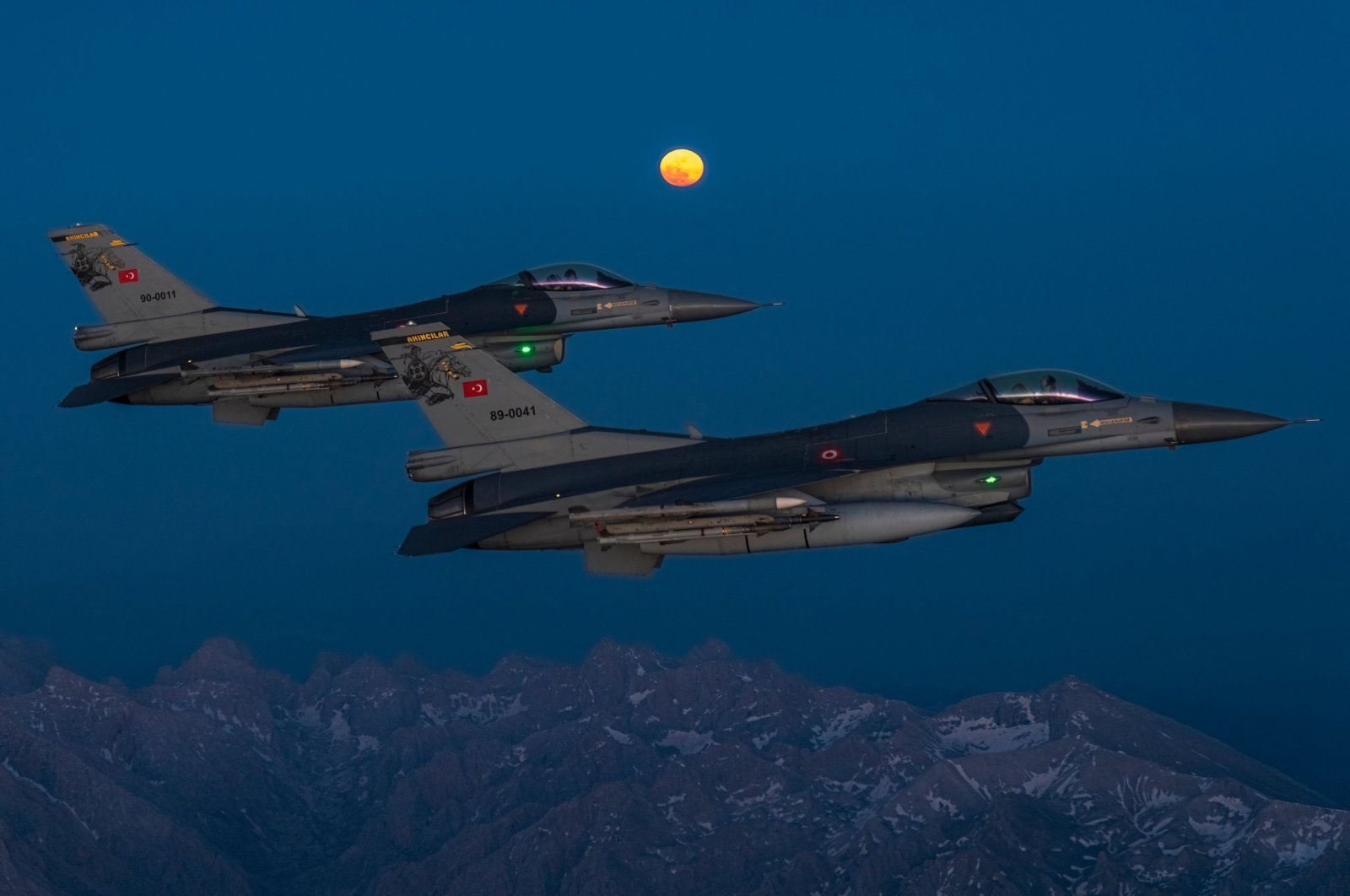 """Turkish F-16 fighter jets fly amid the """"super moon"""" at an unidentified location in Turkey, May 28, 2021. (Defense Ministry handout)"""