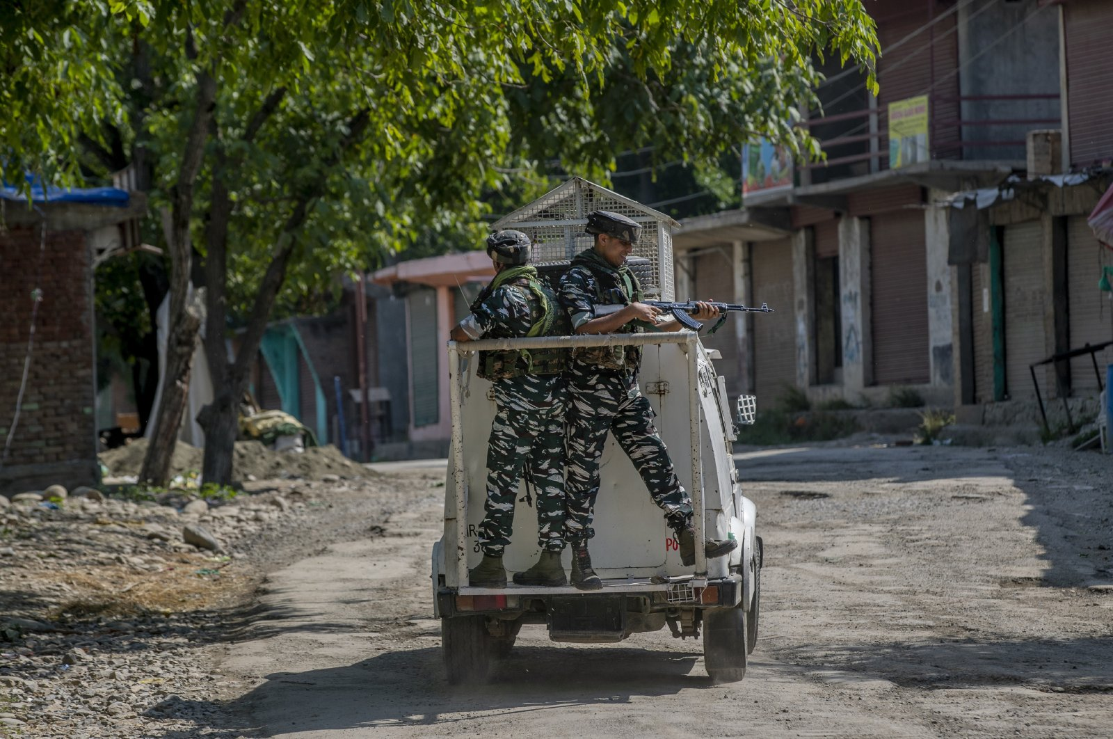 Indian paramilitary soldiers stand guard on an armored vehicle as they move toward the site of a gunfight in Pulwama, south of Srinagar, Indian-controlled Kashmir, July 2, 2021. (AP Photo)
