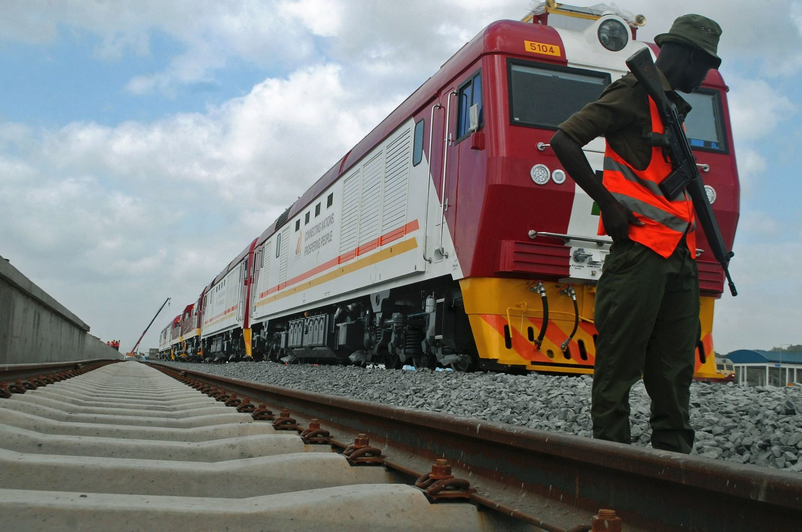 A security guard on patrol during the launch of the first batch of standard gauge railway freight locomotives at the port in Mombasa, Kenya, Jan. 11, 2017. (AFP Photo)