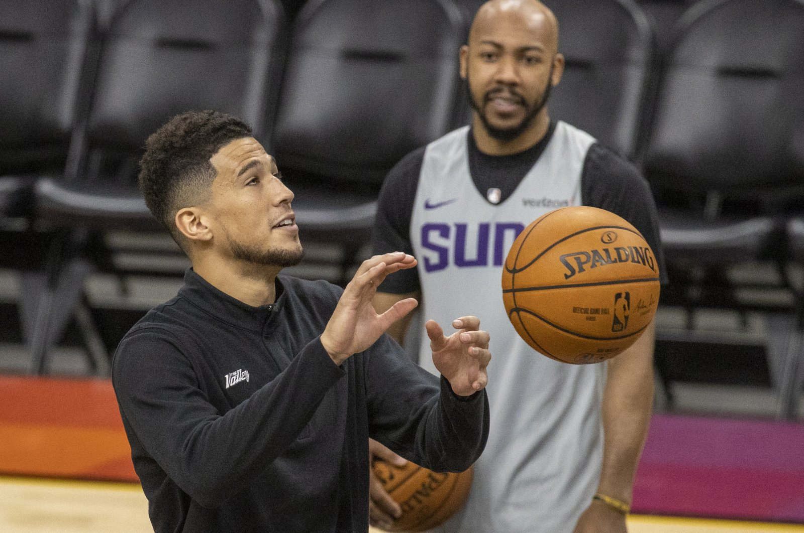 Phoenix Suns guard Devin Booker catches a pass during practice for the NBA Finals against Milwaukee Bucks at Phoenix Suns Arena, Phoenix, Arizona, U.S., July 7, 2021. (EPA Photo)