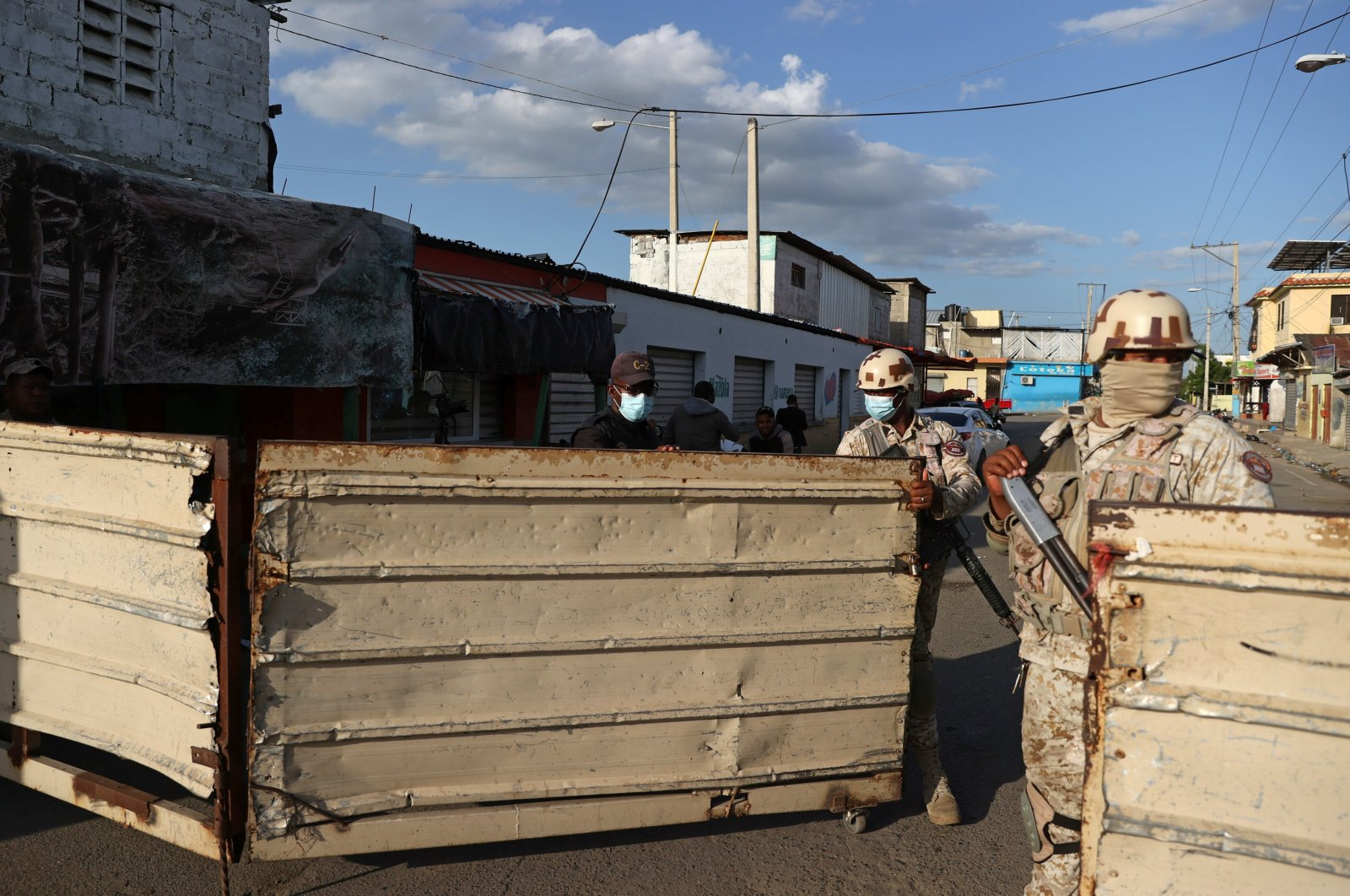 Members of the Dominican Republic's National Army guard the shared border between the Dominican Republic and Haiti, after it was closed when Haiti's President Jovenel Moise was shot dead by gunmen at his private home in Port-au-Prince, in Dajabon, Dominican Republic, July 7, 2021. (Reuters Photo)