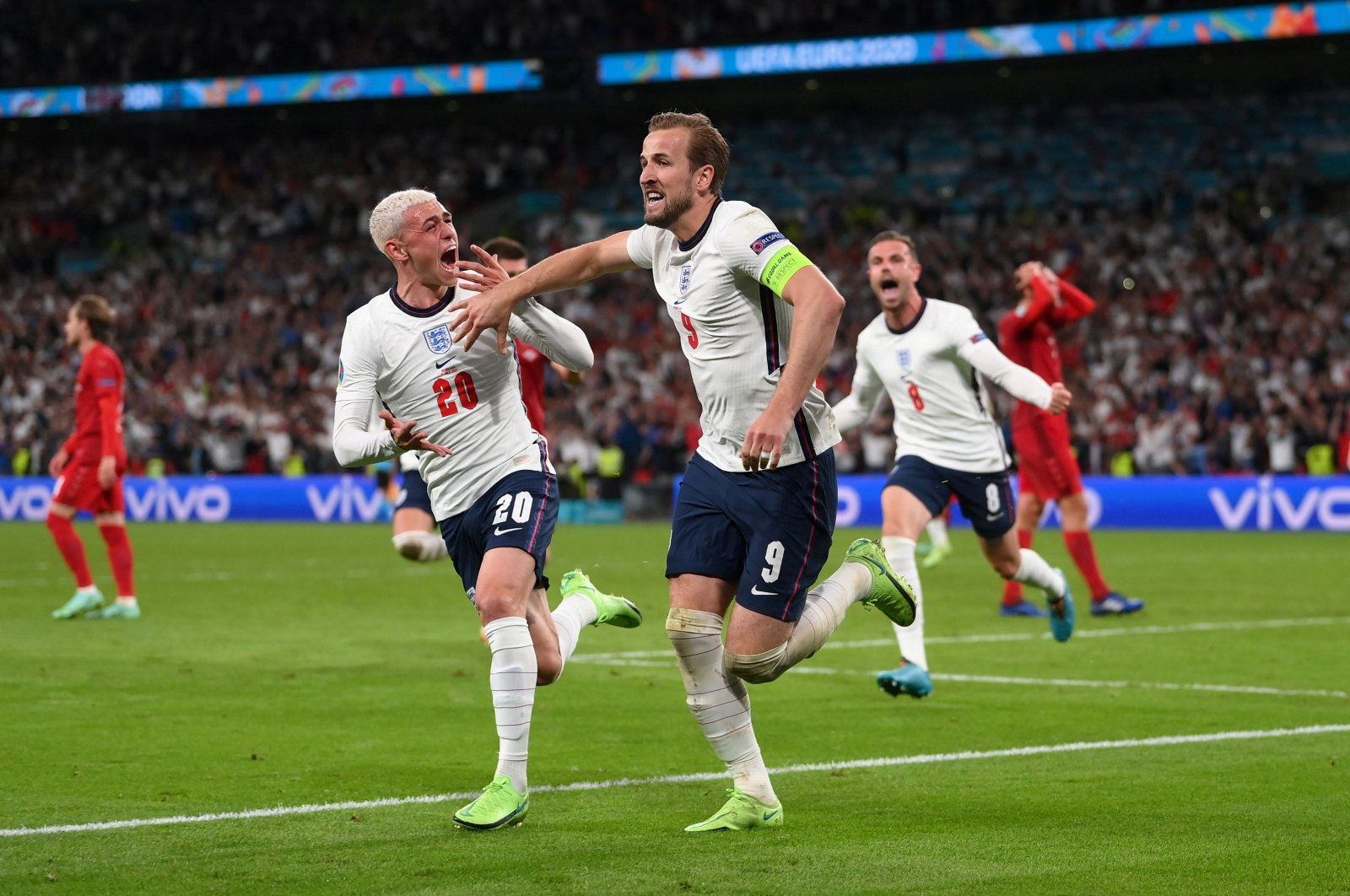 England's Harry Kane (R) celebrates scoring their second goal with Phil Foden in the Euro 2020 semifinal against Denmark at the Wembley Stadium, London, England, July 7, 2021. (Reuters Photo)