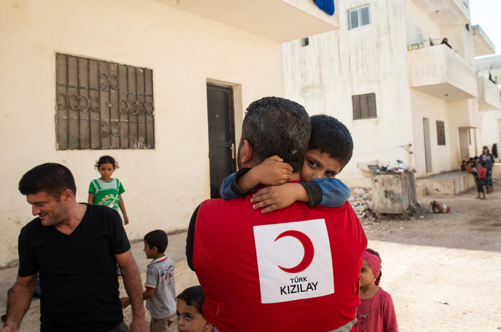 Displaced Syrian children hug a Turkish Red Crescent volunteer at an orphanage, Sept. 17, 2019, Ad Dana, Syria. (Getty Images)