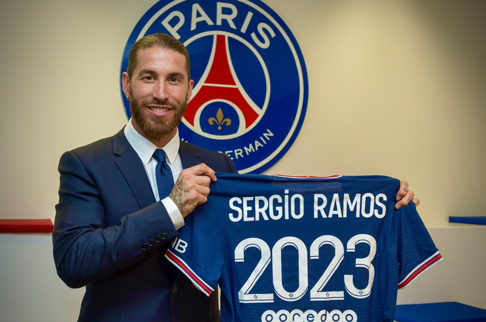 Spanish defender Sergio Ramos poses with a PSG jersey after completing his move to the Ligue 1 club, Paris, France, July 8, 2021. (DHA Photo)