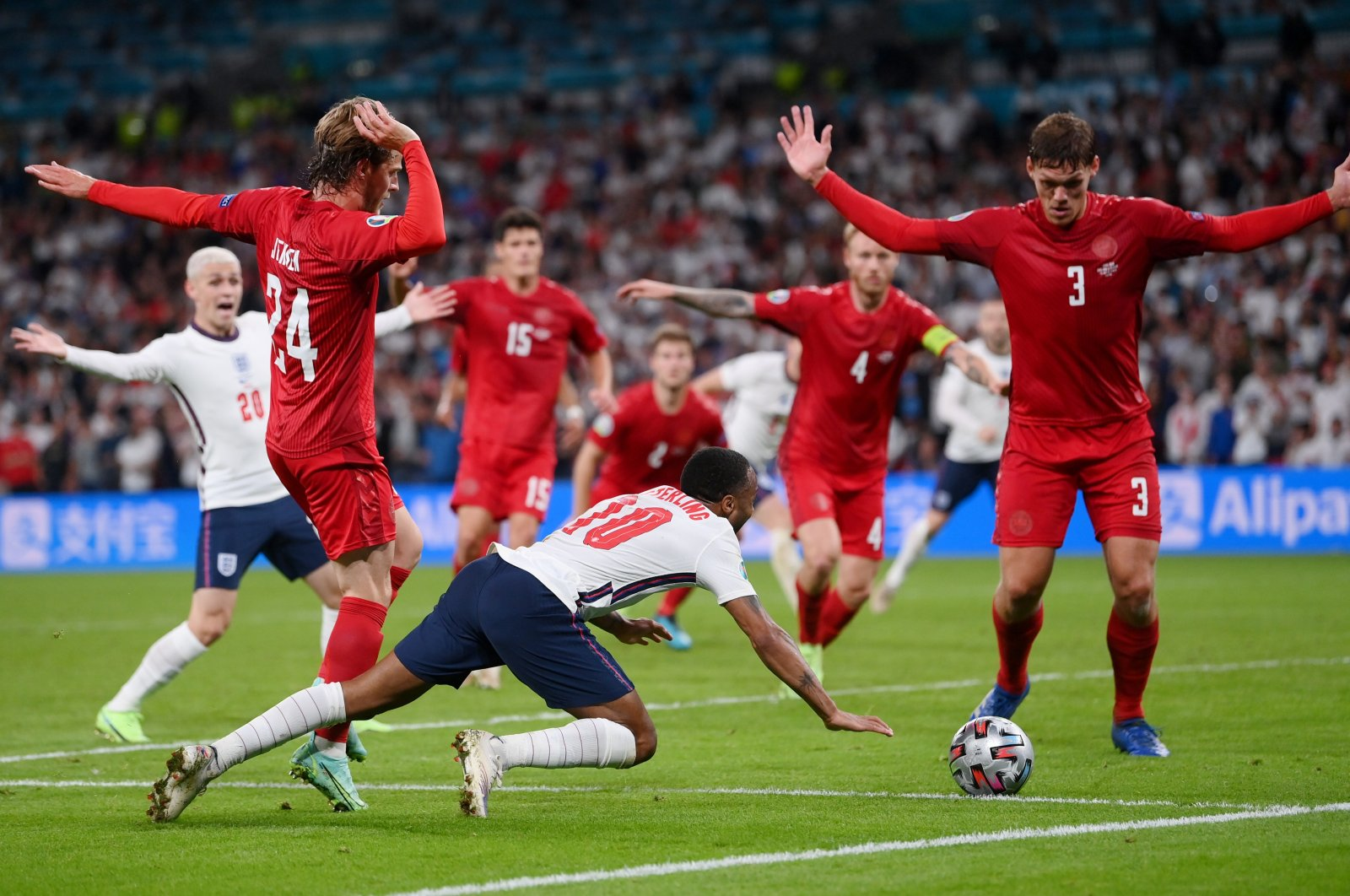 England's Raheem Sterling (C) goes down inside the Denmark penalty box for a penalty during the Euro 2020 semifinal at the Wembley Stadium, London, Britain, July 7, 2021. (Reuters Photo)