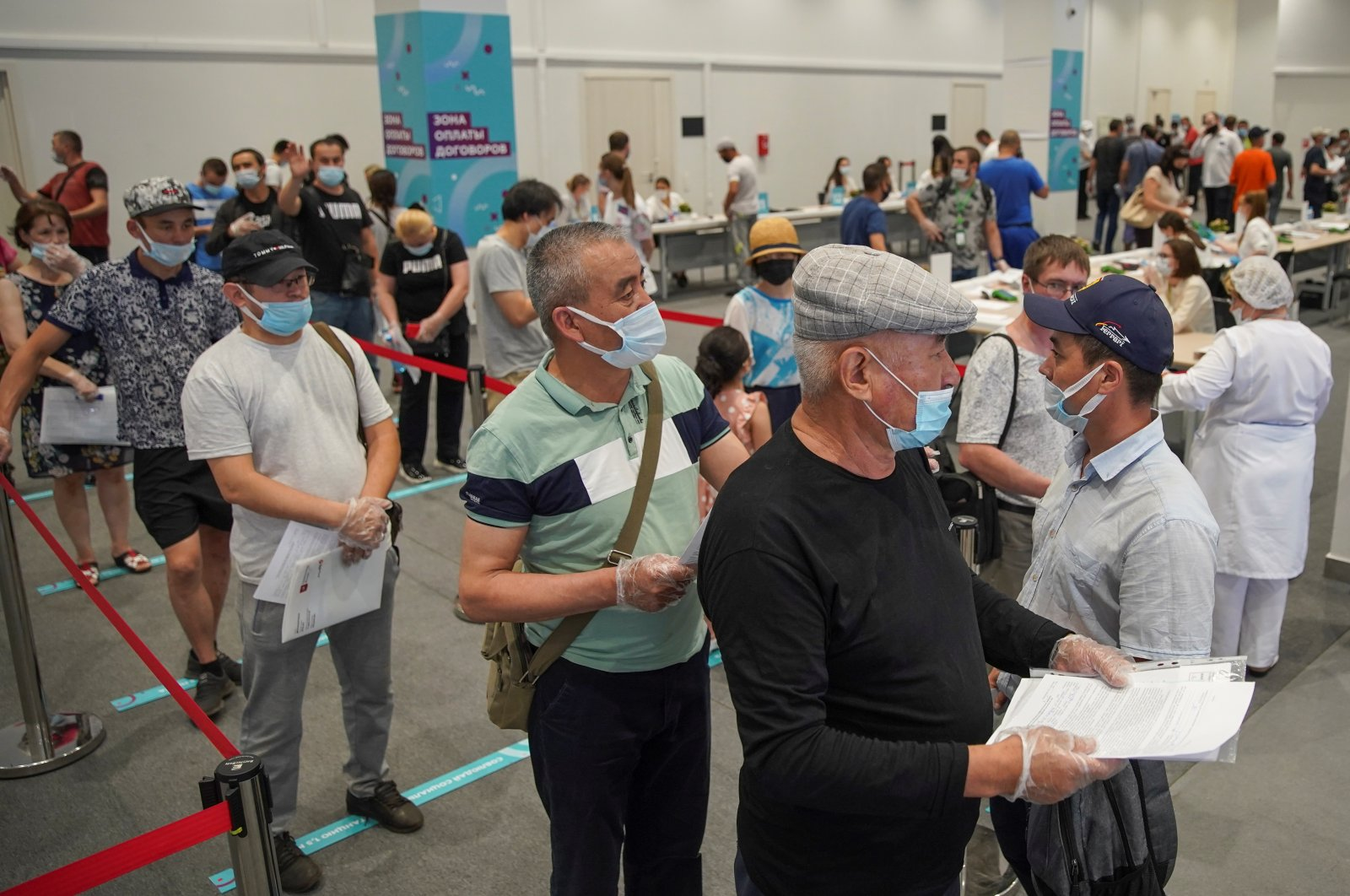 People wait to receive a vaccine against the coronavirus at a vaccination center in Luzhniki Stadium in Moscow, Russia July 8, 2021. (Reuters Photo)