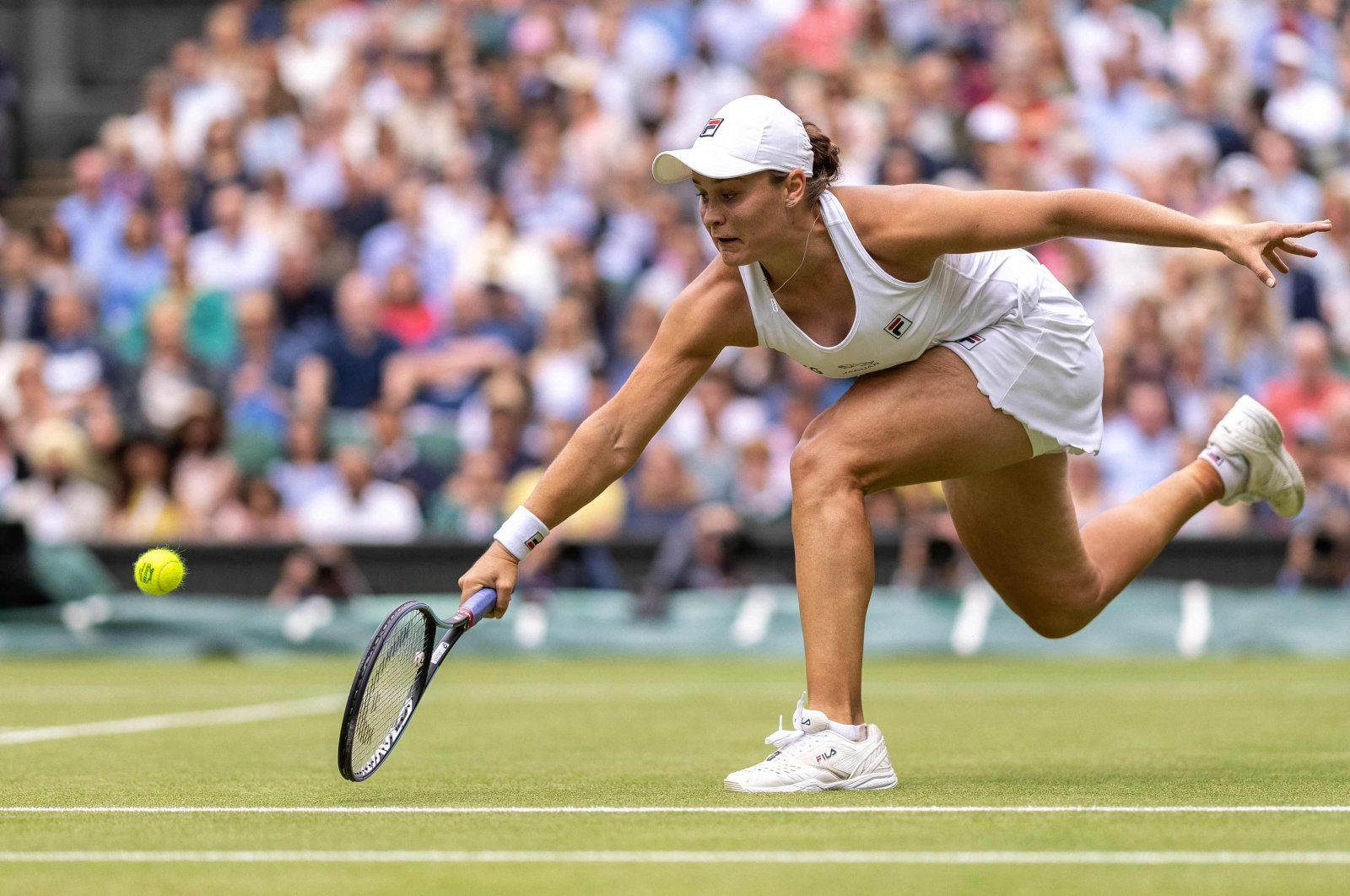 Australia's Ashleigh Barty returns against Germany's Angelique Kerber during their Wimbledon women's semifinal match at The All England Tennis Club, Wimbledon, southwest London, England, July 8, 2021. (AFP Photo)