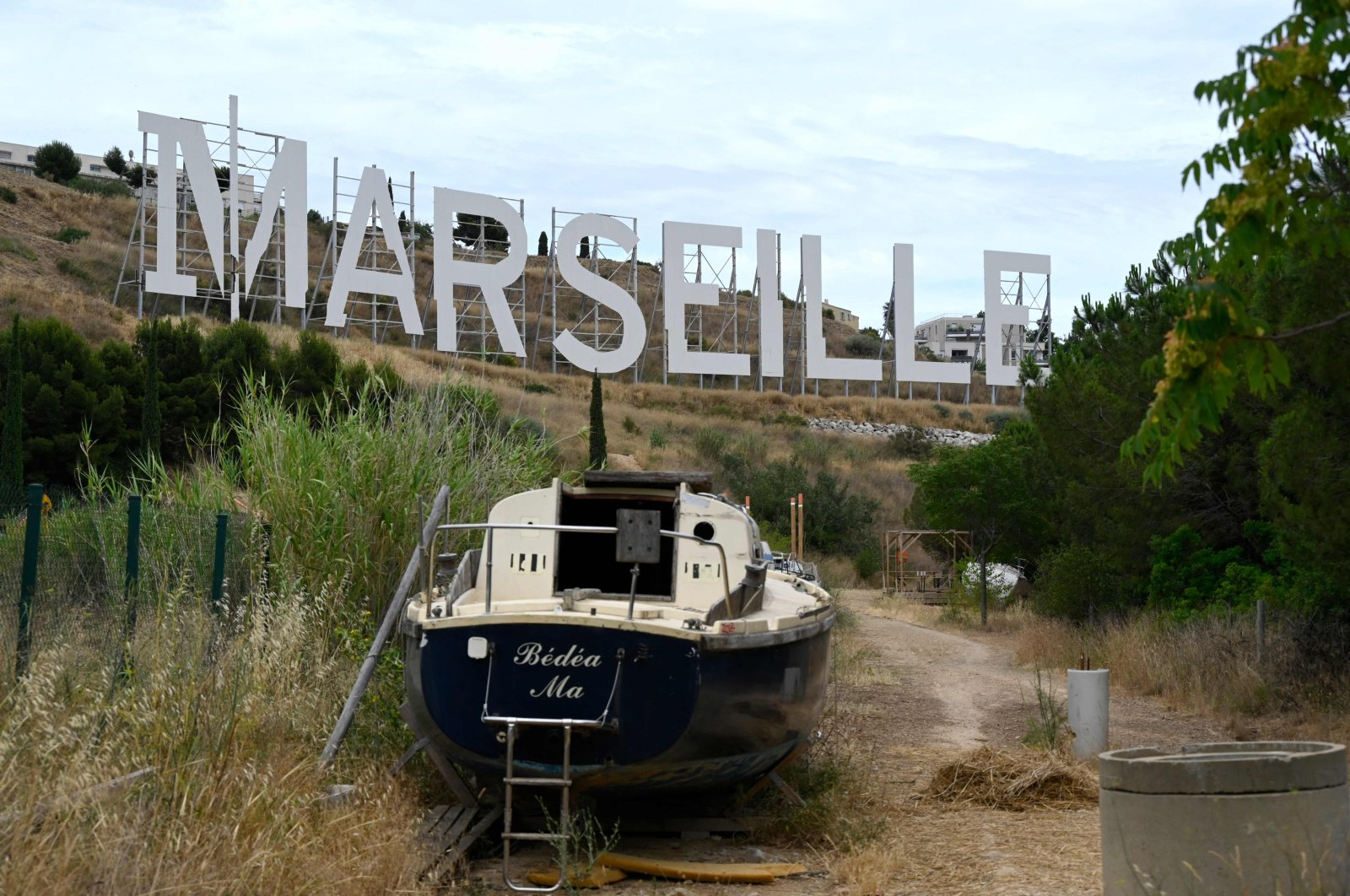 """A giant sign similar to the one in Hollywood was installed by Netflix while the firm shoots the famous TV show """"Marseille,"""" in Marseille, southern France, July 7, 2021. (AFP Photo)"""