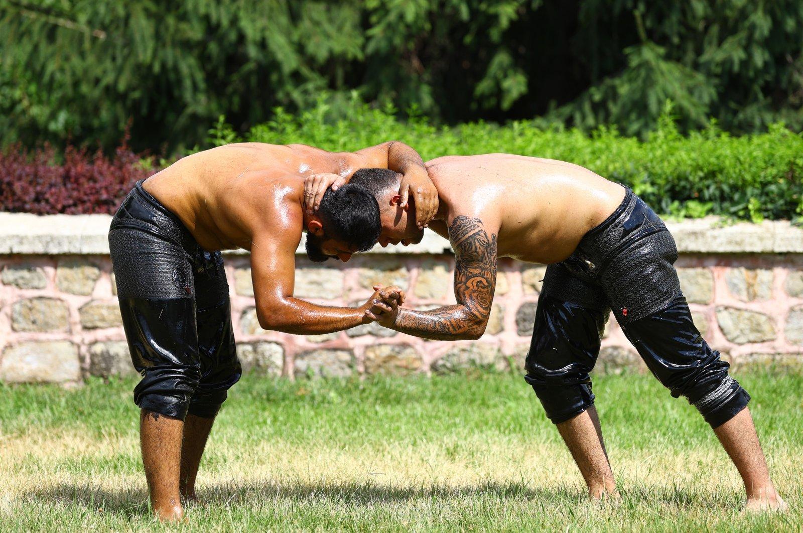 Wrestlers prepare to compete in the 660th Kırkpınar Oil Wrestling Festival, Edirne, Turkey, July 8, 2021. (AA Photo)