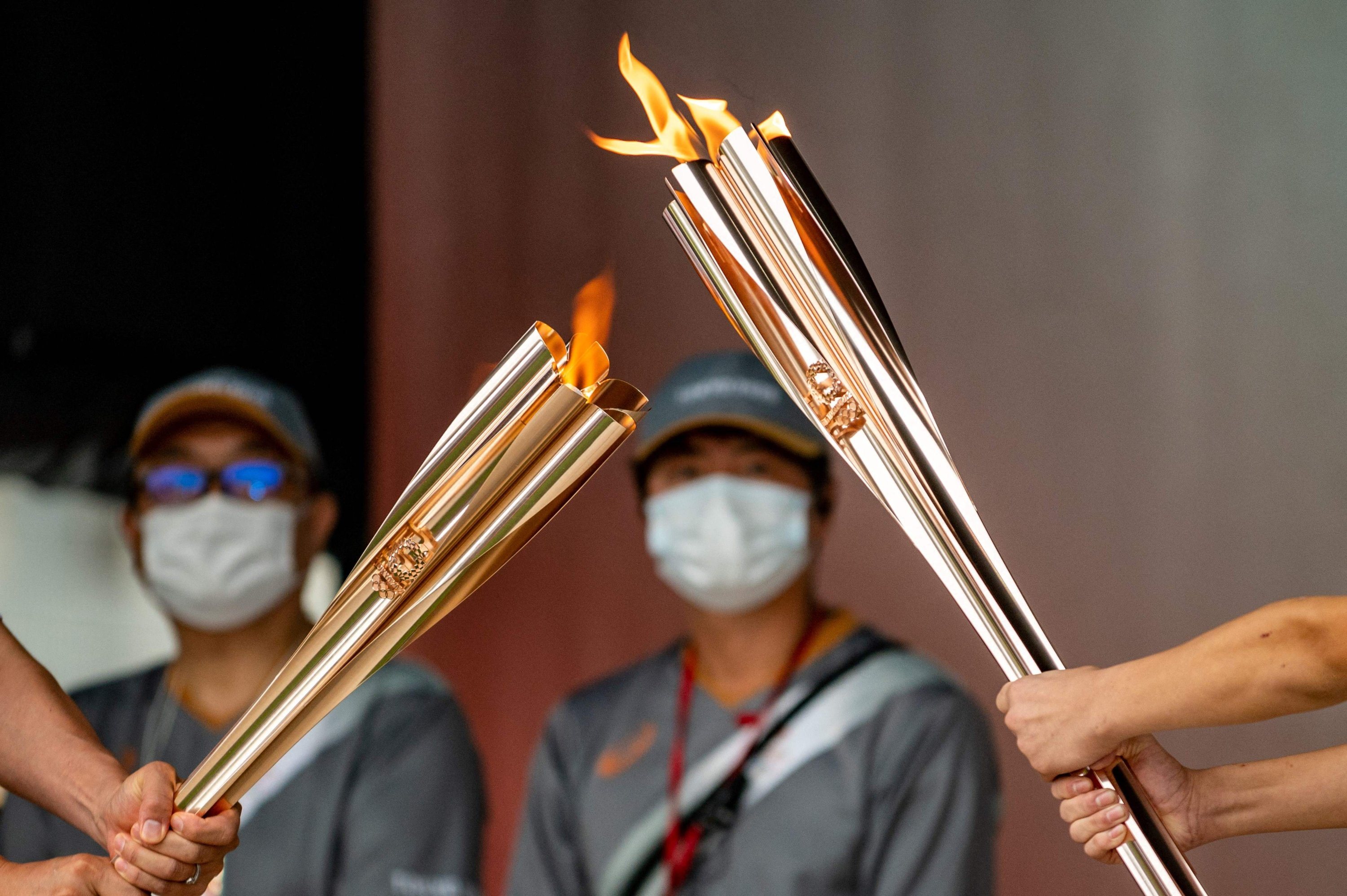Olympic flames are seen during the lighting ceremony at Machida Shibahiro, on the first day of the torch relay in Tokyo, Japan, July 9, 2021. (AFP Photo)