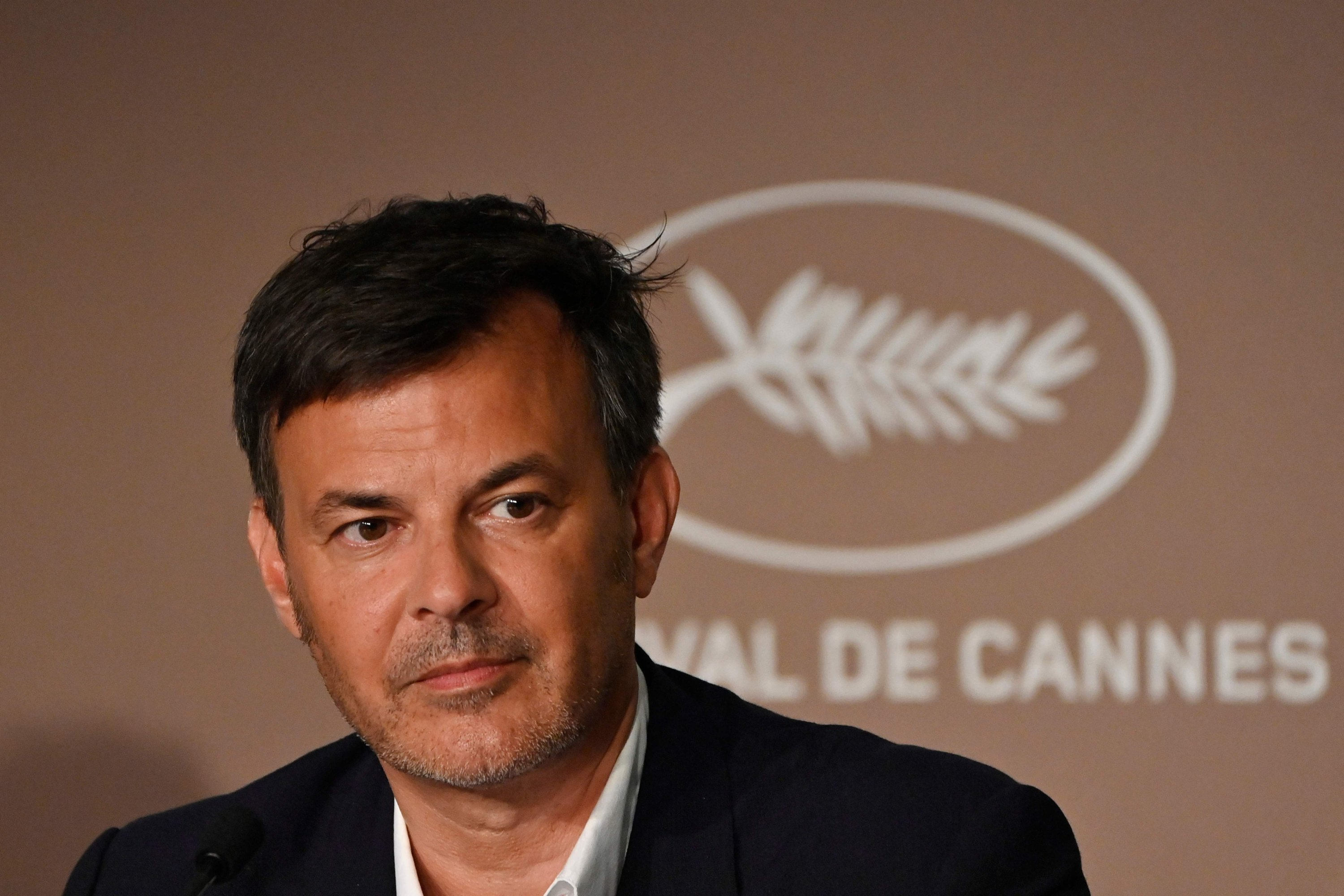 French director Francois Ozon attends a press conference for the film 'Tout s'est Bien Passe' ('Everything Went Fine') at the 74th edition of the Cannes Film Festival in Cannes, southern France, July 8, 2021. (Photo by John MACDOUGALL / AFP)