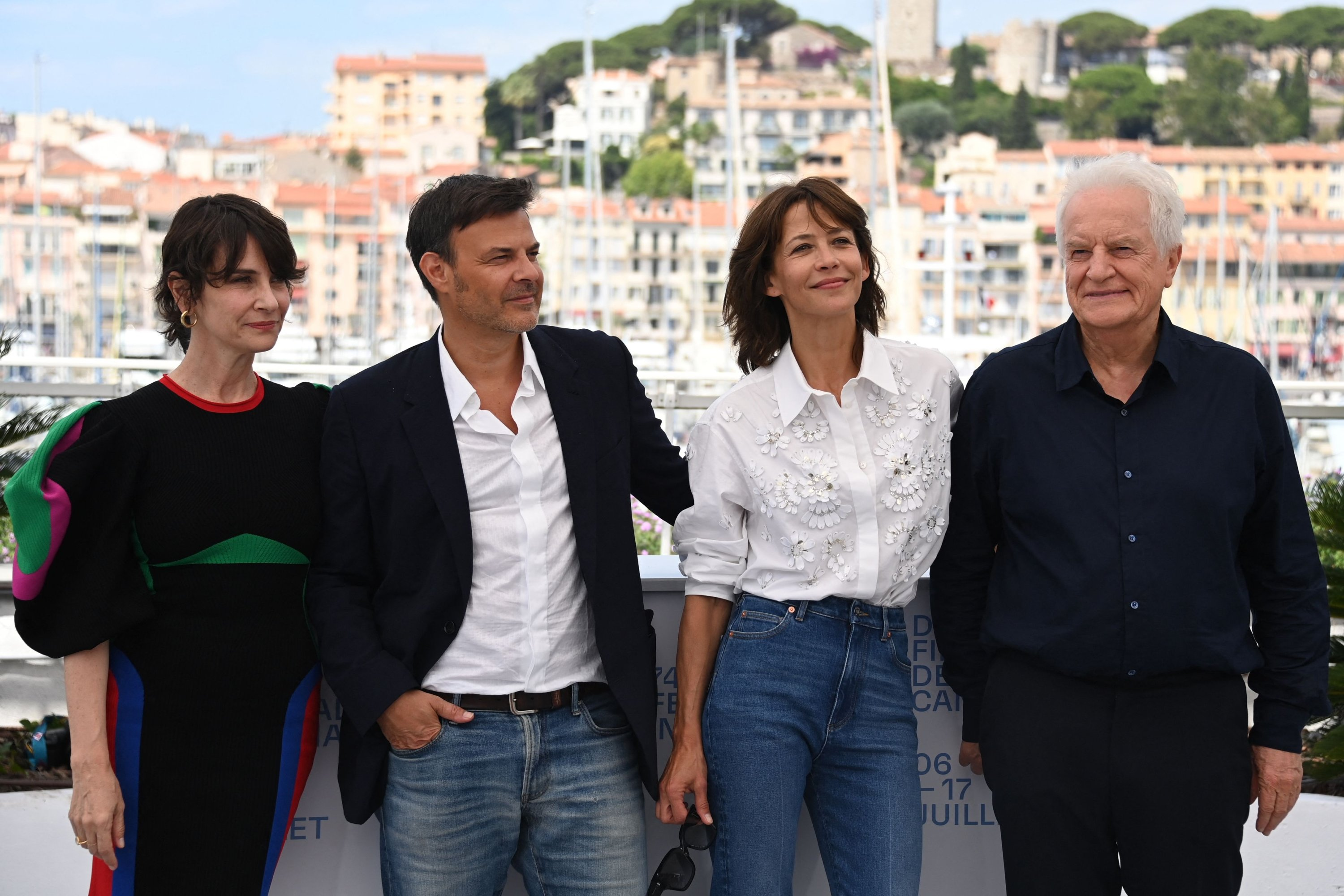 From left to right, French actress Geraldine Pailhas, French director Francois Ozon, French actress Sophie Marceau and French actor Andre Dussollier pose for a photocall for the film 'Tout s'est Bien Passe' ('Everything Went Fine') at the 74th edition of the Cannes Film Festival in Cannes, southern France, July 8, 2021. (AFP Photo)