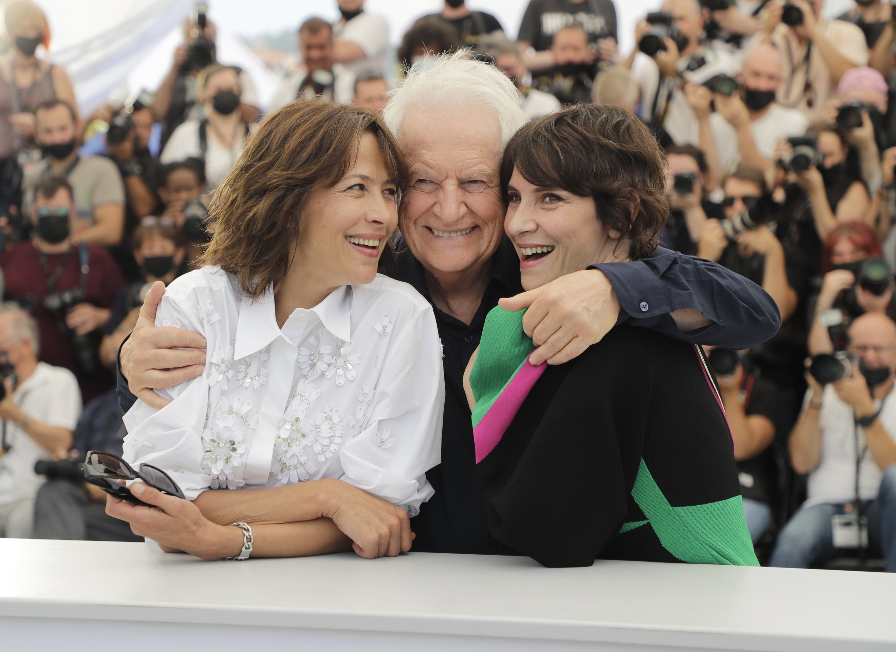 Sophie Marceau (L), Andre Dussollier (C) and Geraldine Pailhas (R) pose for photographers at the photocall for the film 'Everything Went Fine' at the 74th international film festival, Cannes, southern France, Thursday, July 8, 2021. (AP Photo)