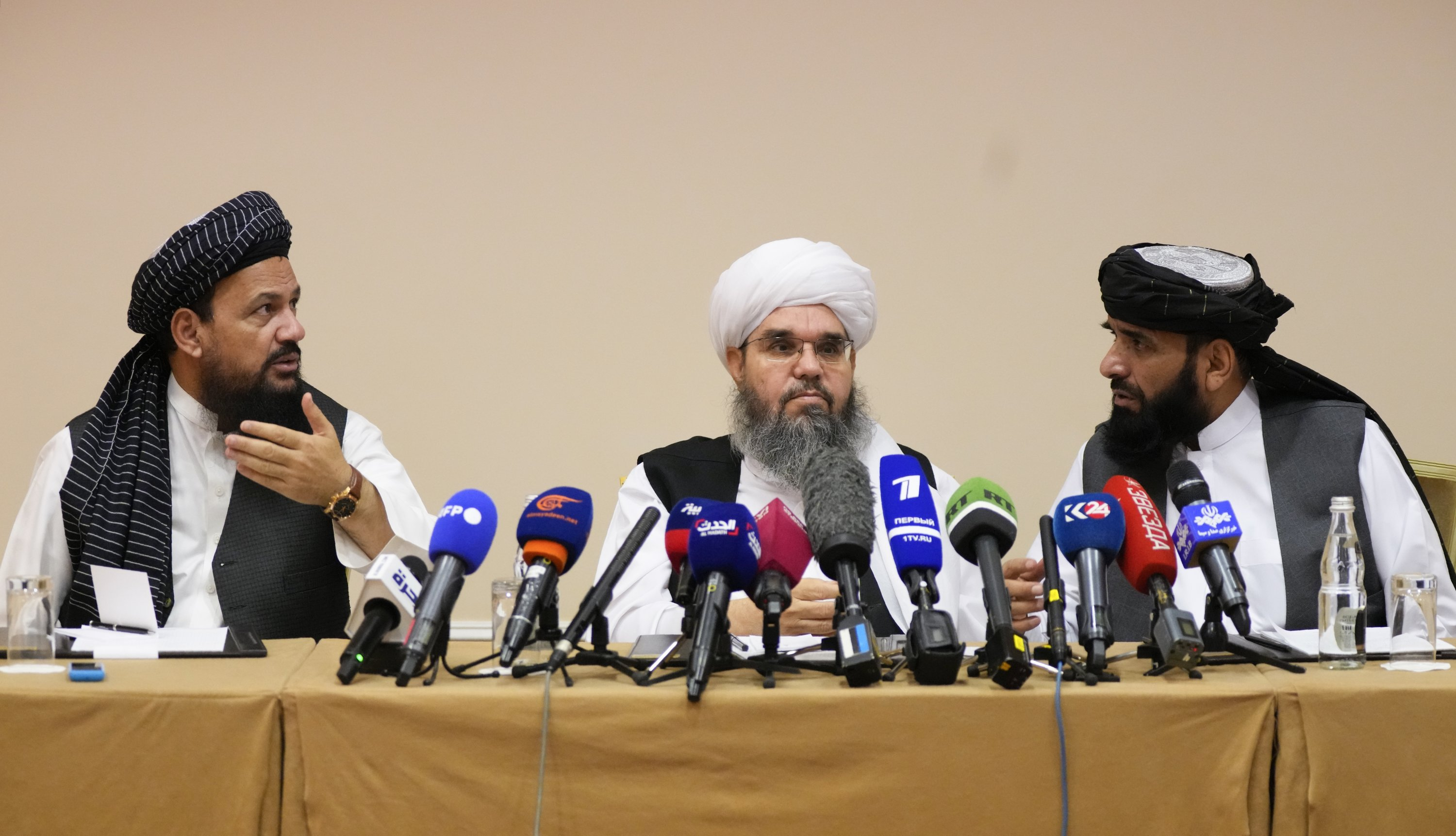 From left, Mohammad Naim, Mawlawi Shahabuddin Dilawar and Suhil Shaheen, members of a political delegation from the Afghan Taliban's movement, attend a news conference in Moscow, Russia, July 9, 2021. (AP Photo)