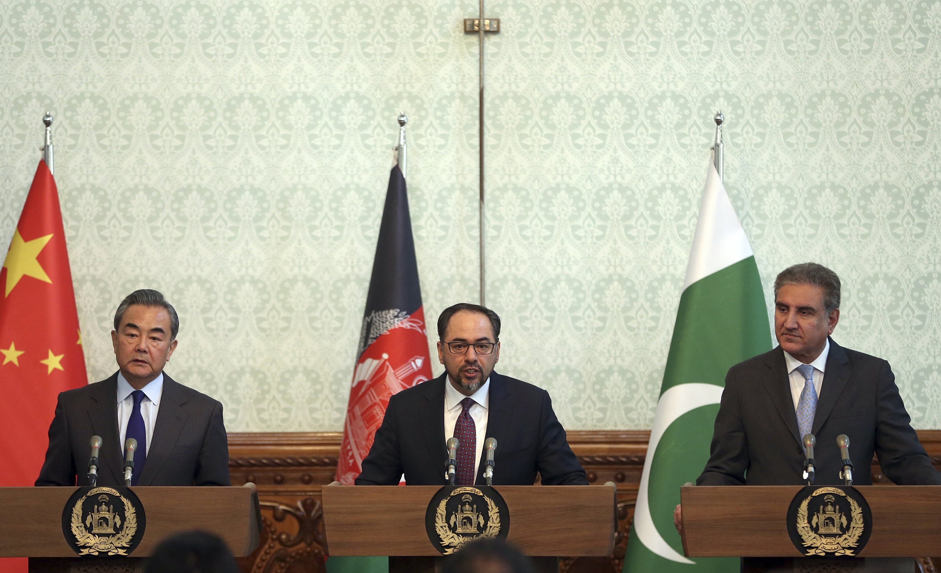 Afghanistan's then-Foreign Minister Salahuddin Rabbani, center, speaks as Pakistani Foreign Minister Shah Mehmood Qureshi, first right, and Chinese Foreign Minister Wang Yi, first left, listen during a joint press conference at the presidential palace in Kabul, Afghanistan, Dec. 15, 2018. (AP Photo)