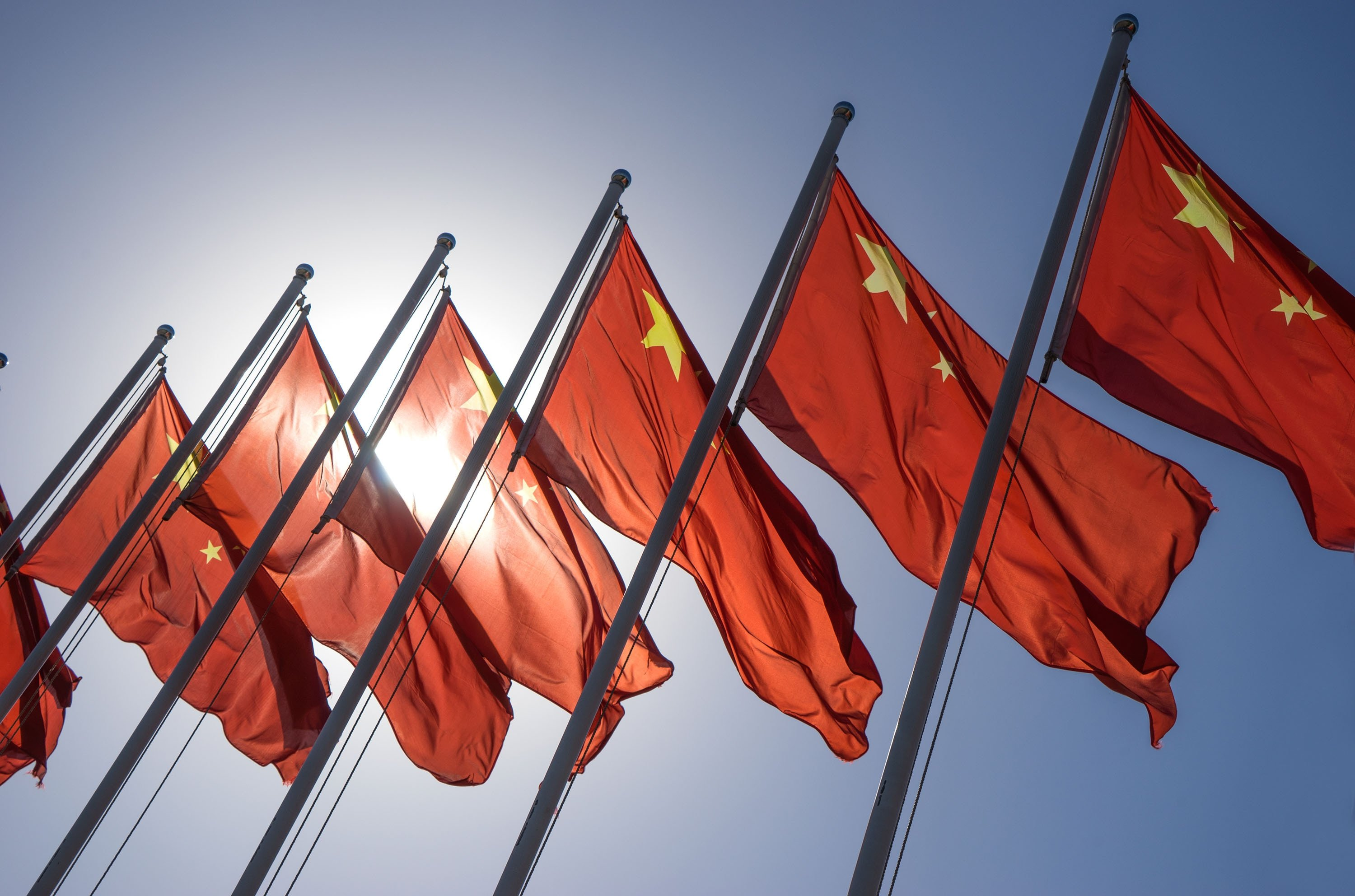 A line of Chinese flags waves on a sunny day. (Shutterstock Photo)