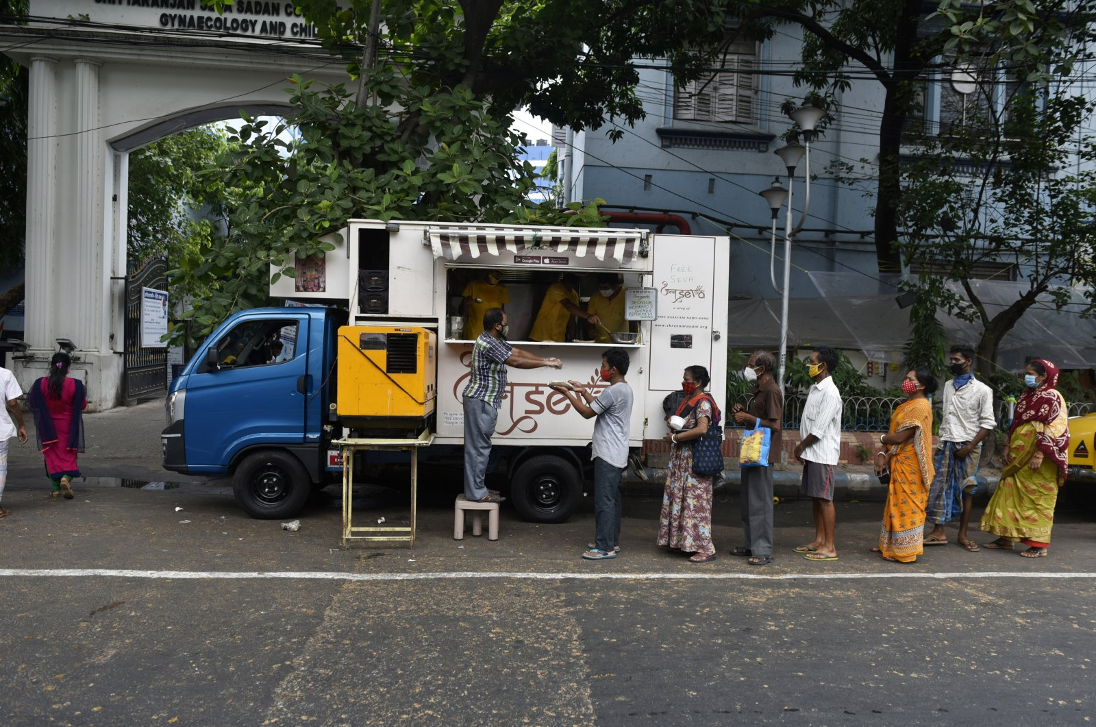 People queue for free food during the COVID-19 outbreak in Kolkata, India, May 23, 2021. (Getty Images)
