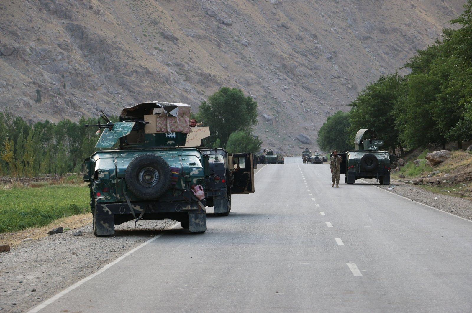 Afghan soldiers pause on a road at the front line of fighting between Taliban and Security forces, near the city of Badakhshan, northern Afghanistan, July. 4, 2021. (AP Photo)