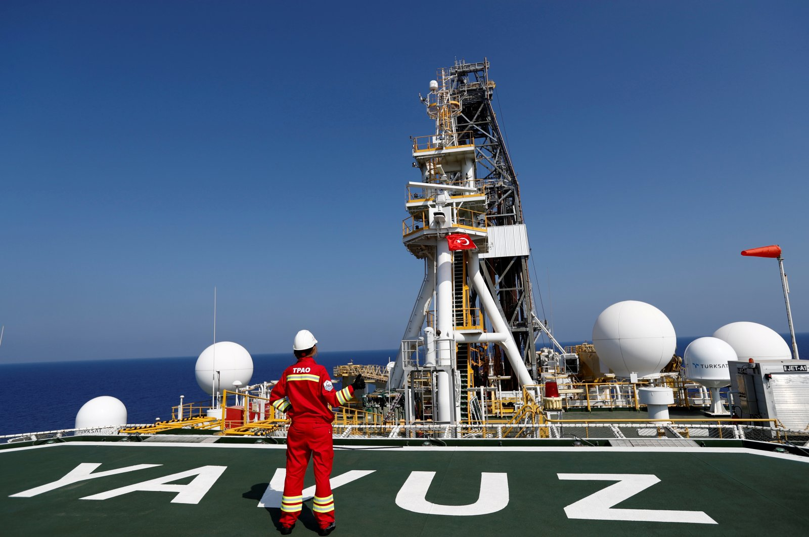 A Turkish Petroleum Corporation (TPAO) engineer poses on the helipad of Turkish drilling vessel Yavuz in the Eastern Mediterranean, Aug. 6, 2019. (Reuters Photo)